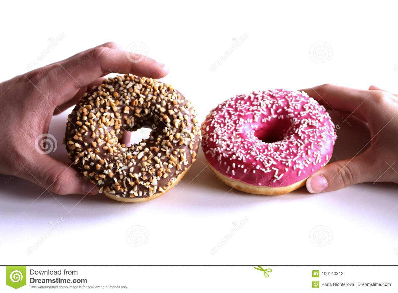 Donuts in hands collection, on white background.Top view.