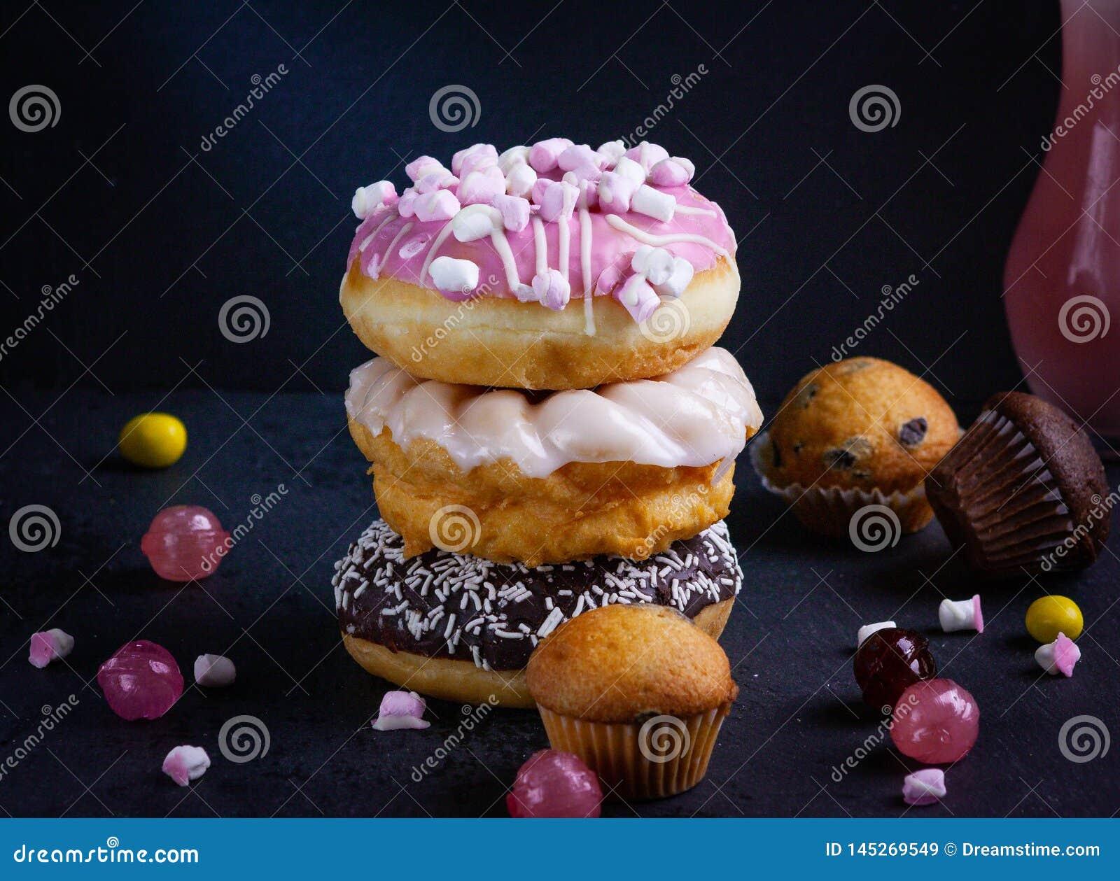 Donuts tower on dark background.