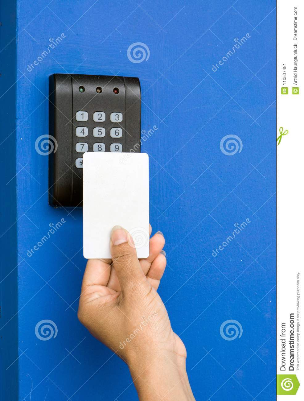 Young woman holding a key card to lock and unlock door.,
