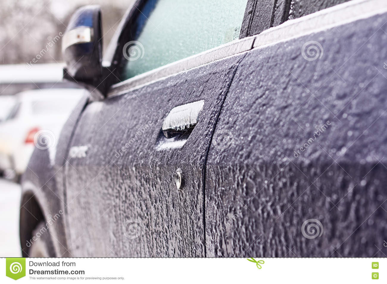 Door, Knob, Keyhole Of Car Covered With Snow And Ice After A