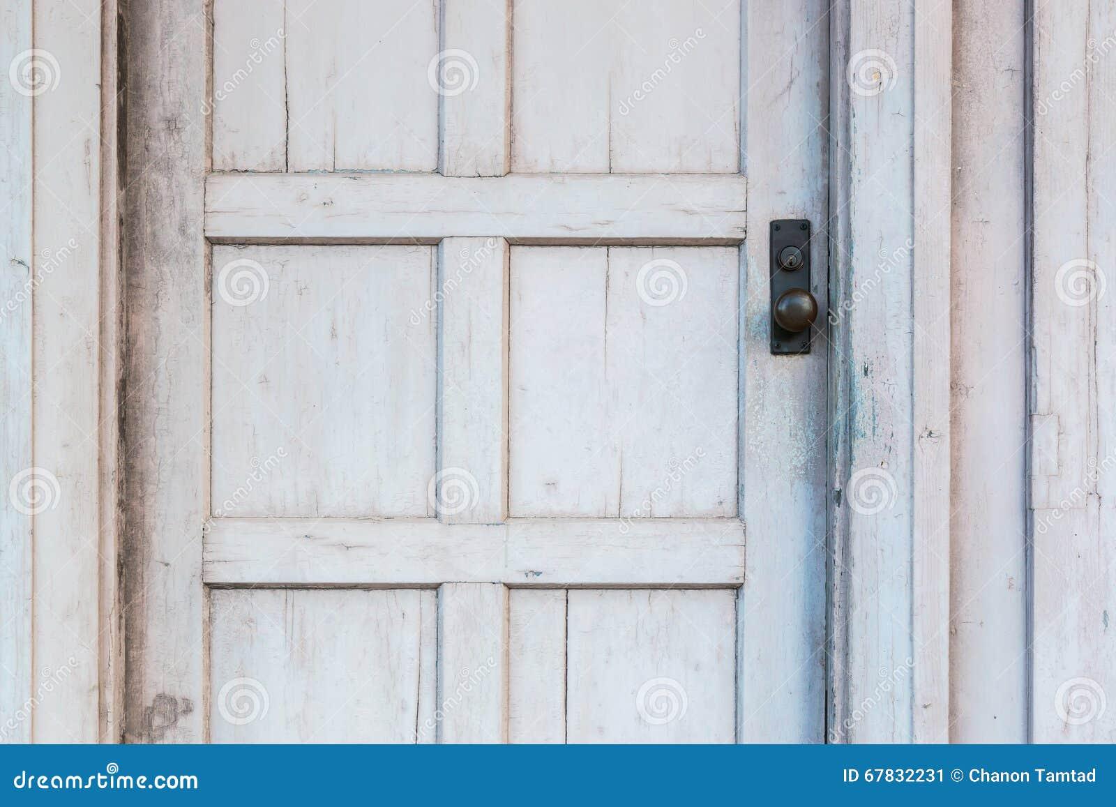 White Wood Door : Door knob on old white wooden stock photo image