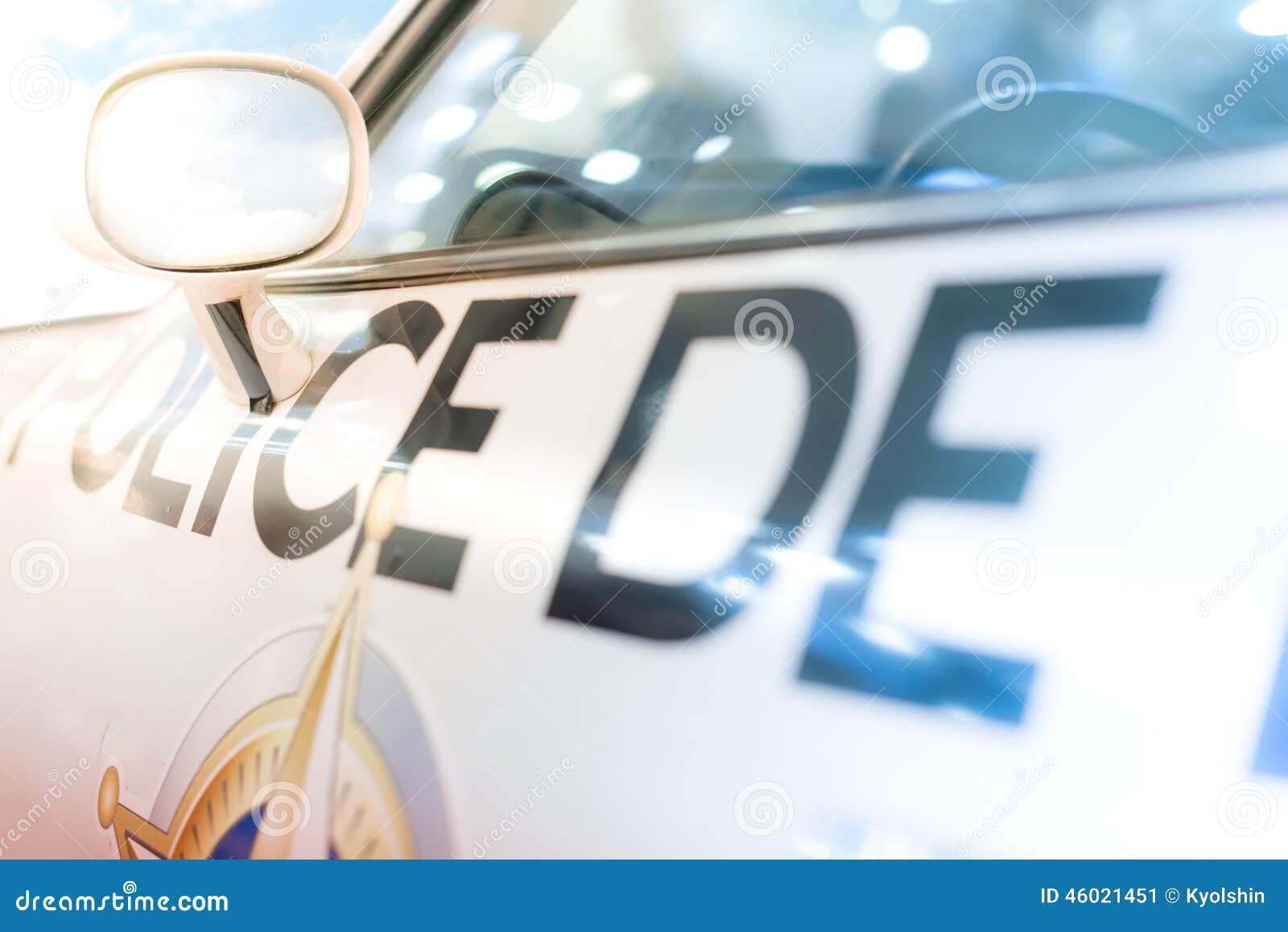 Door, window and side mirror of police car.