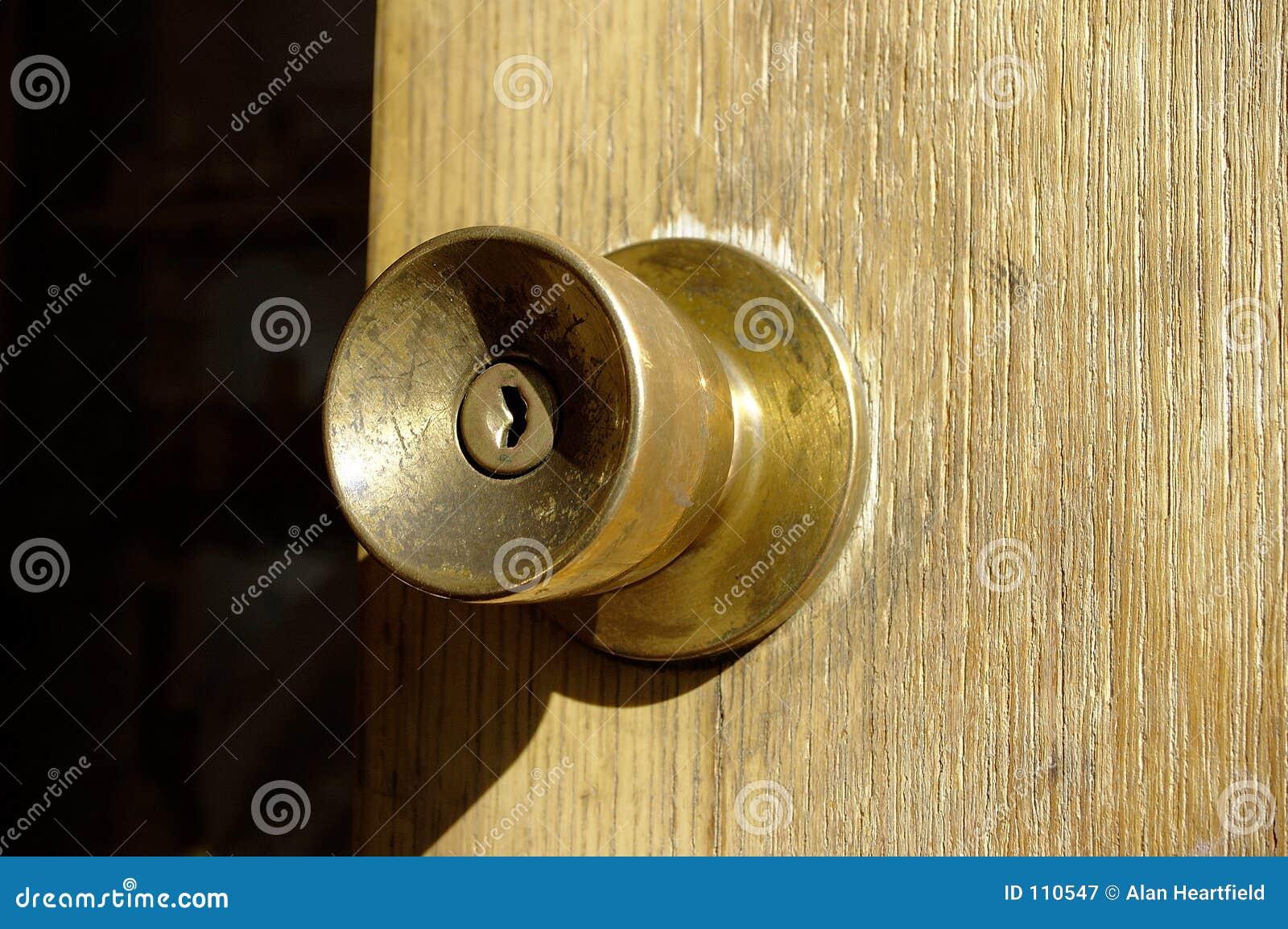 Doorknob de bronze velho