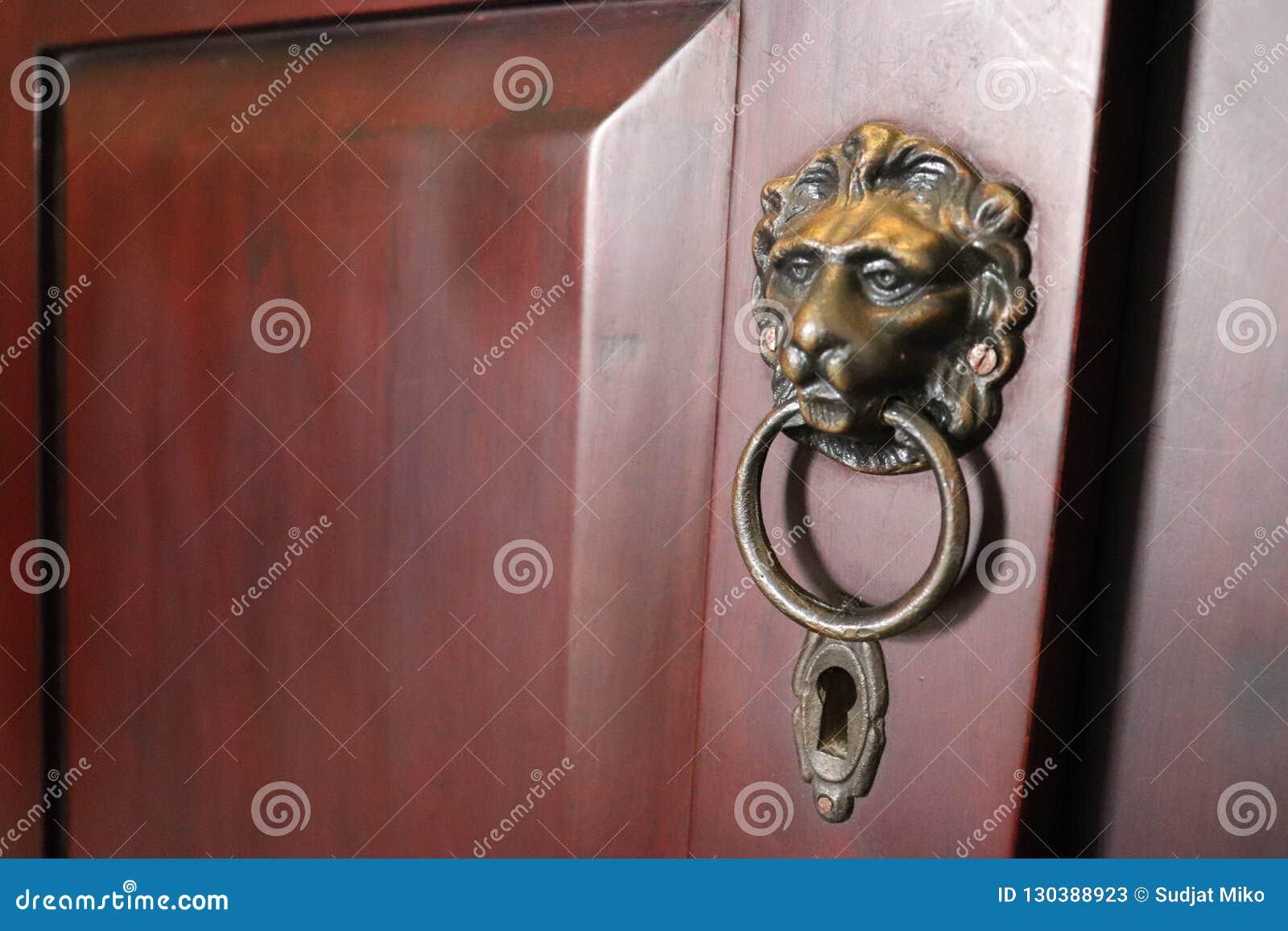 Doorknob golden lion head and keyhole