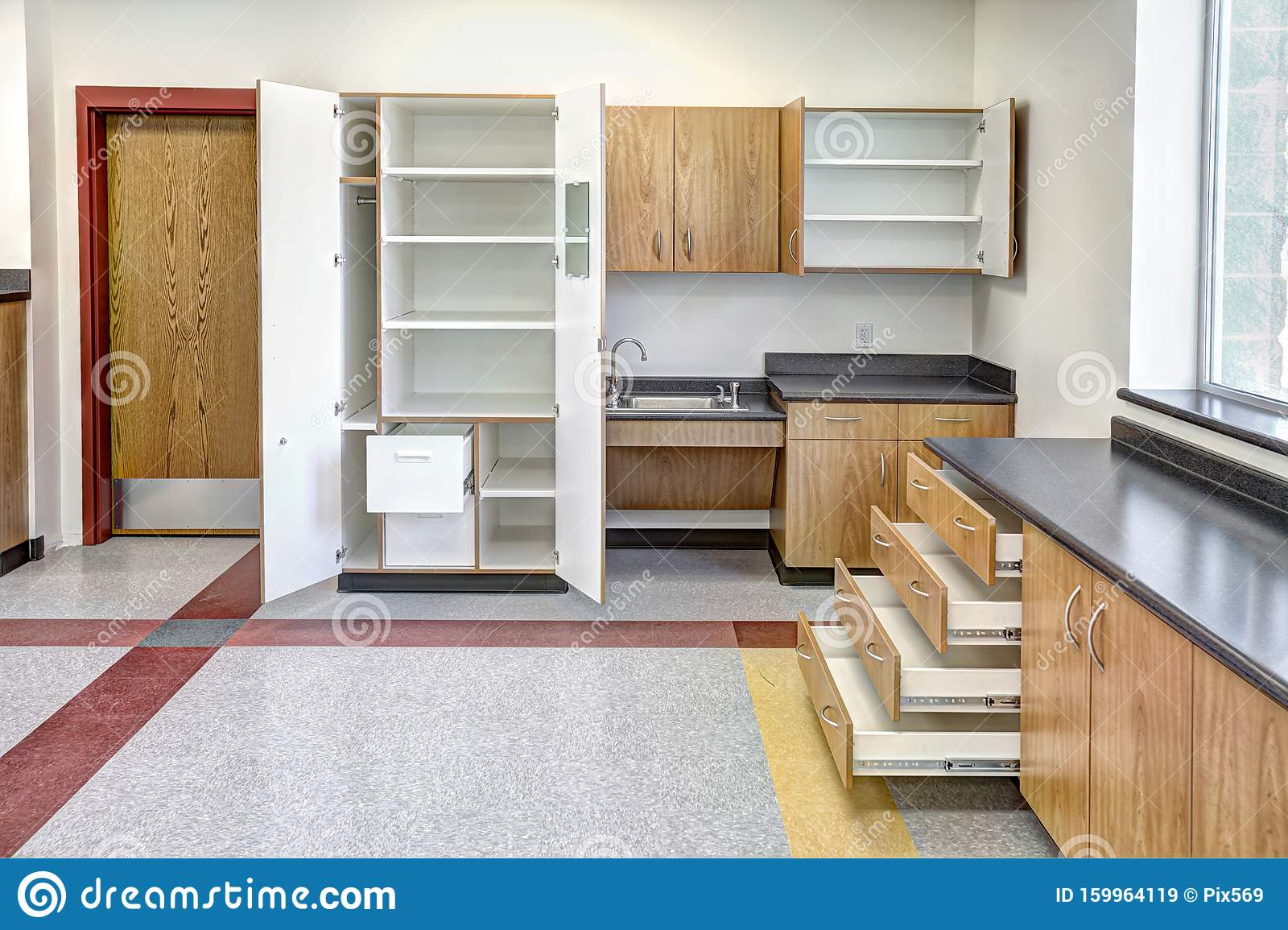 Doors And Drawers Open On New Cabinets In A School. Stock ...