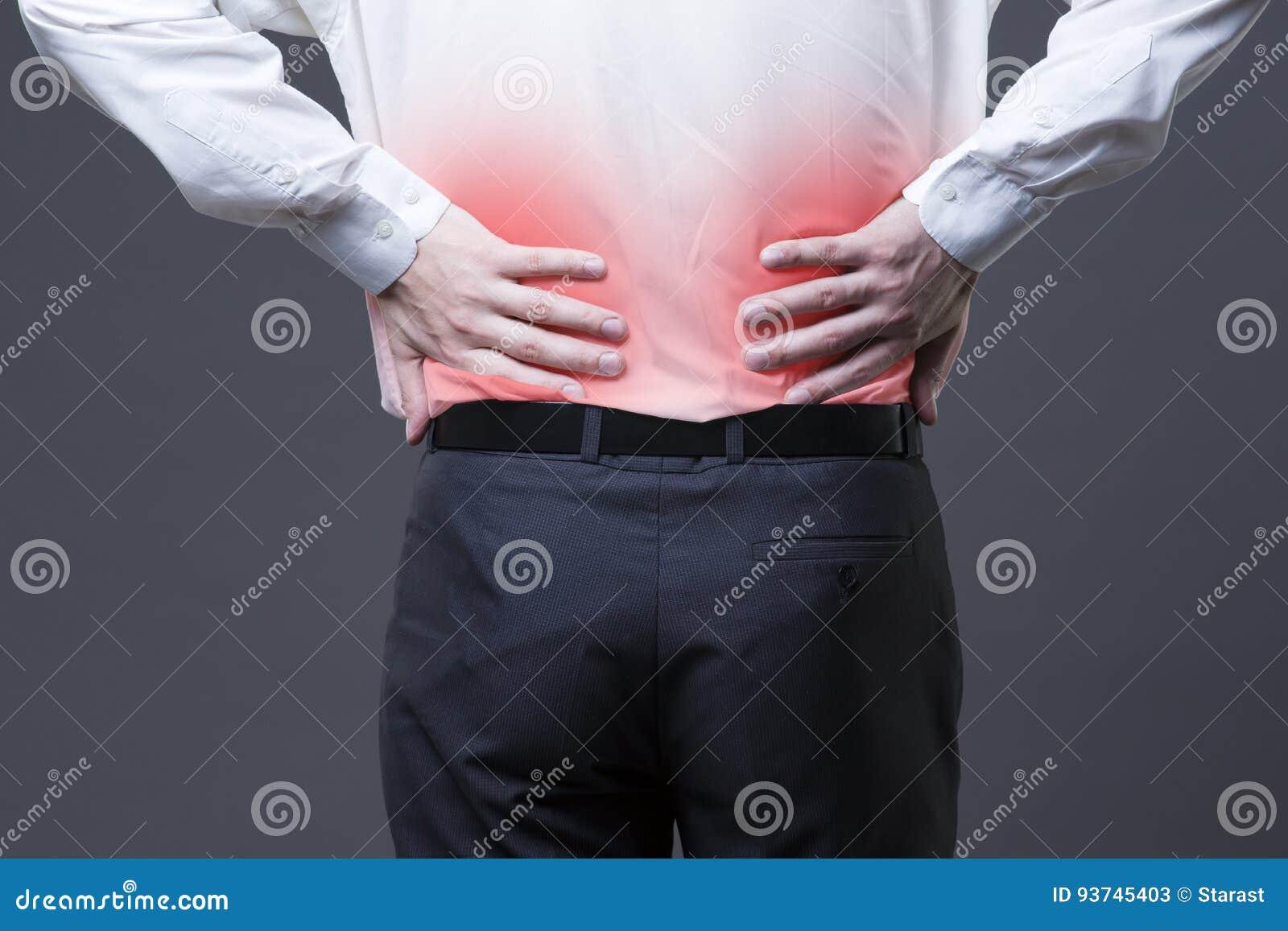 Dor nas costas, inflamação do rim, dor no corpo do ` s do homem