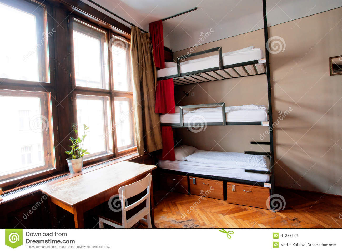 Dorm Room Of Cheap Hostel With Level Beds Stock Photo