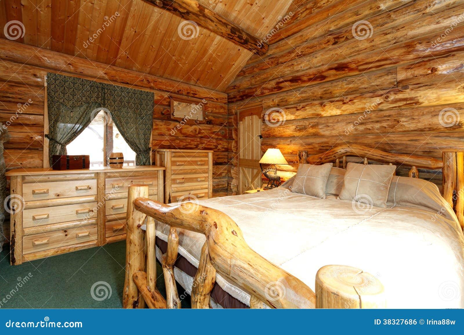 Dormitorio acogedor en casa de la caba a de madera imagen - Casa de la madera ...