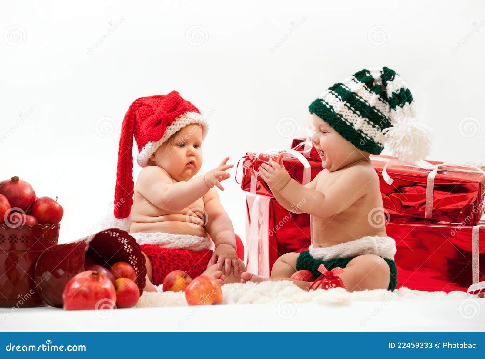 Dos beb s lindos en trajes de la navidad fotos de archivo - Trajes de navidad para bebes ...