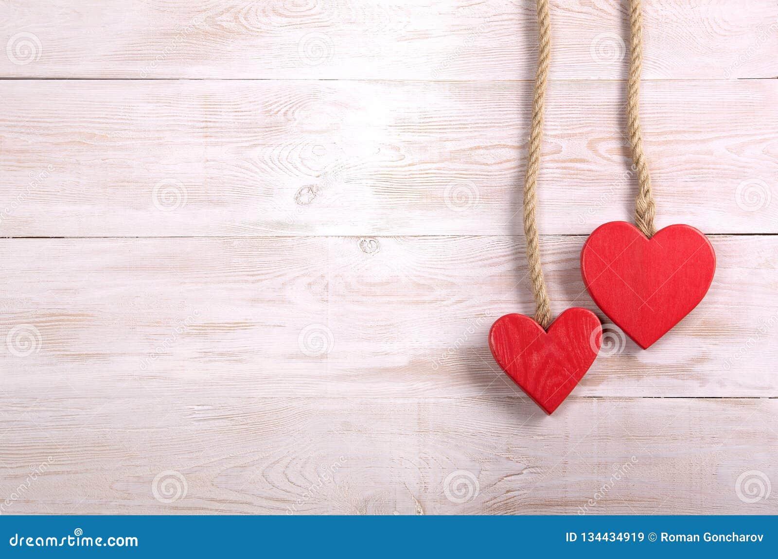 Dos corazones bacground de día de San Valentín