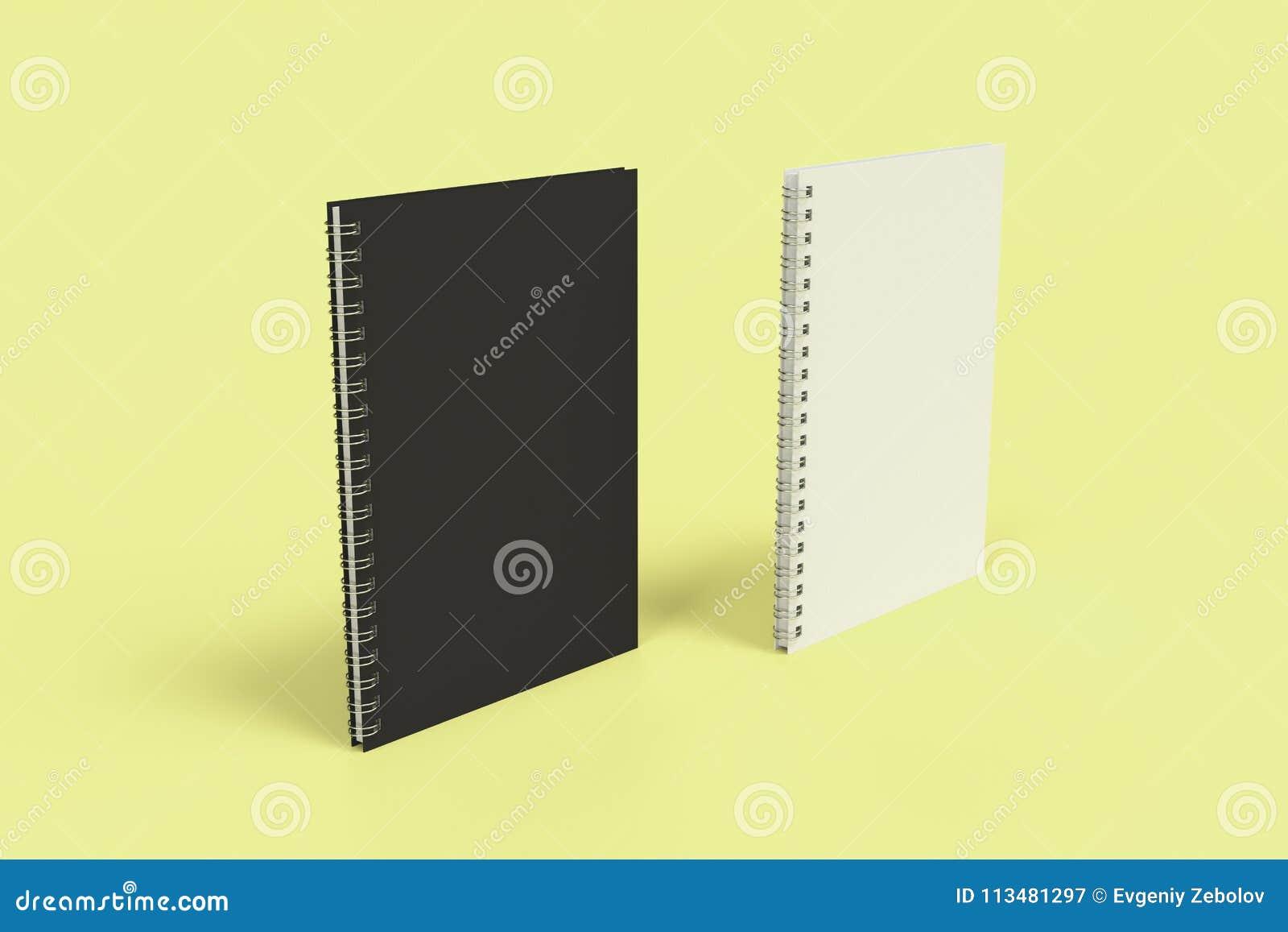Dos cuadernos con espiral - limite en fondo amarillo
