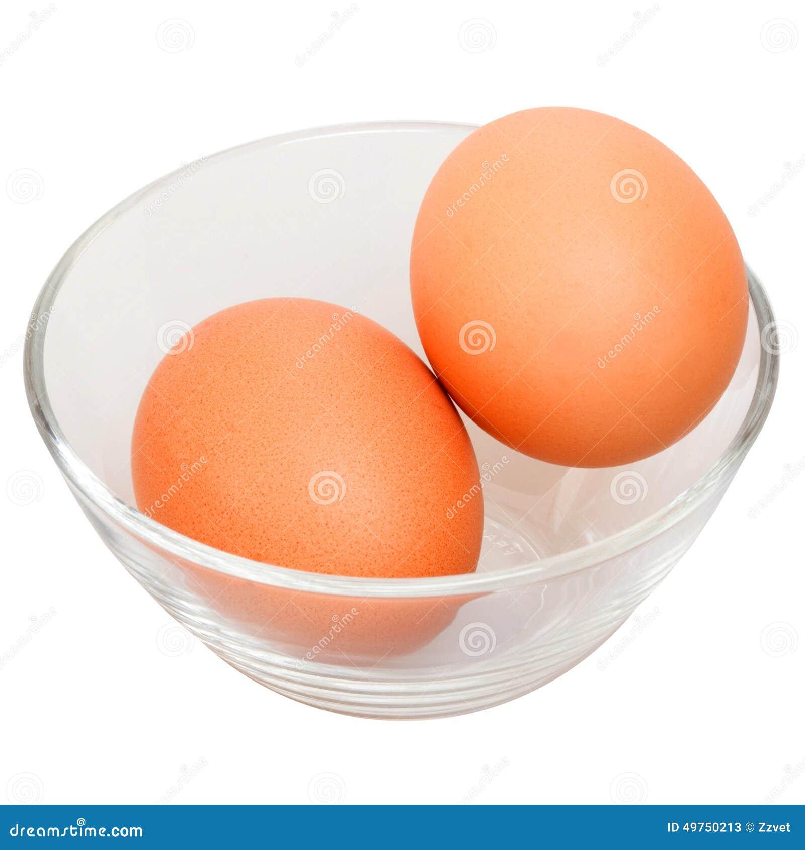 Dos huevos crudos en bol de vidrio imagen de archivo - Bol de vidrio ...