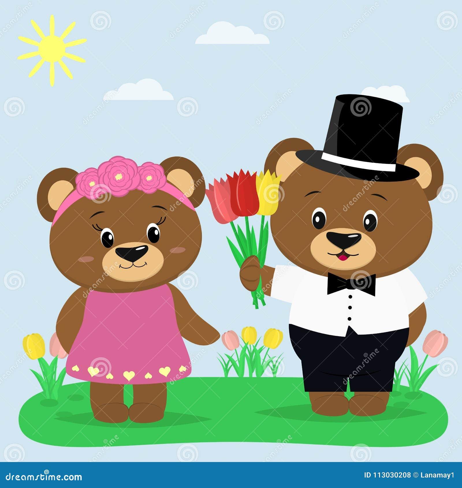 Dos osos marrones en ropa en un claro del verano Un muchacho da tulipanes a una muchacha