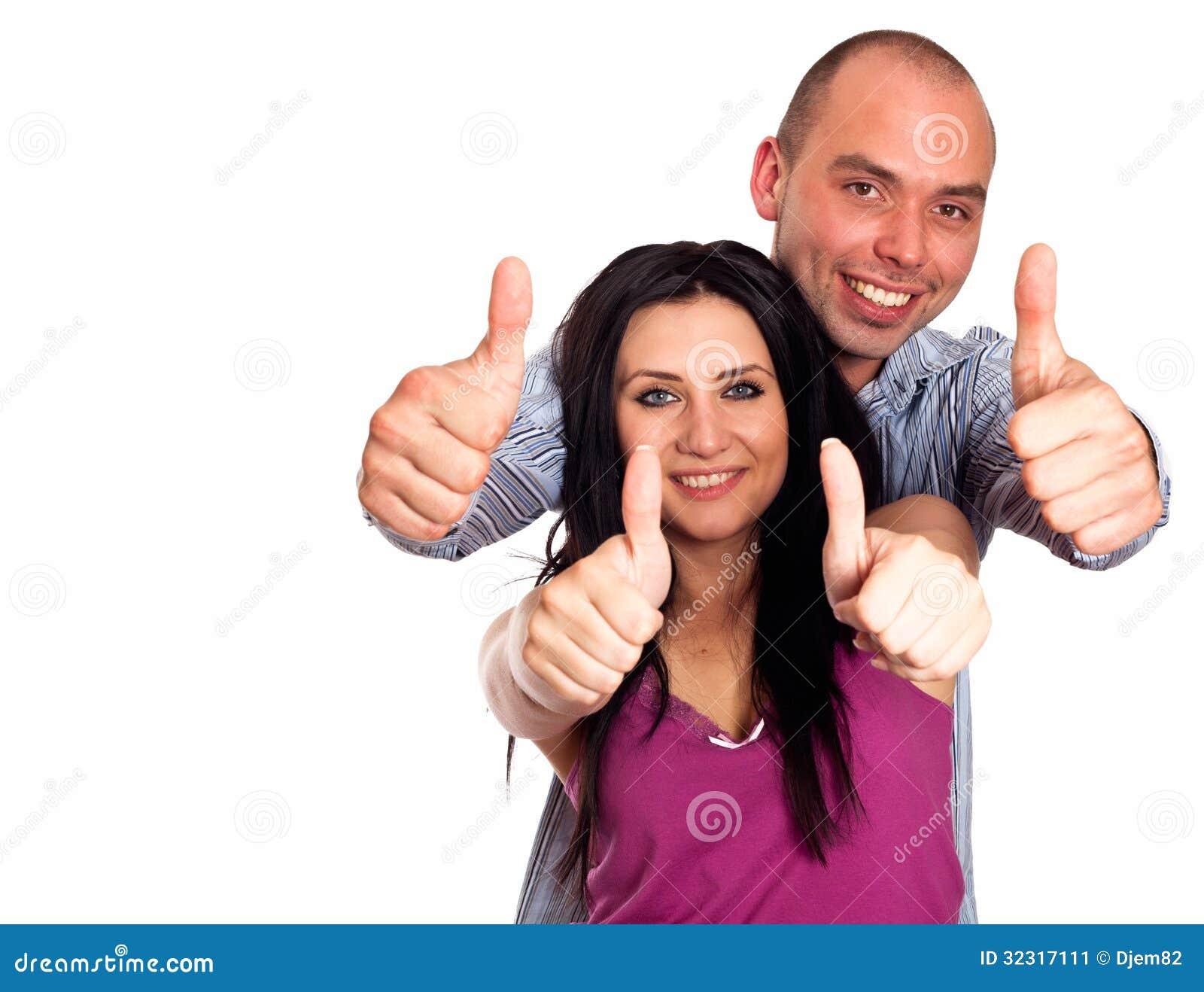 Dos personas sonrientes jovenes con los pulgares para for Jacuzzi para dos personas