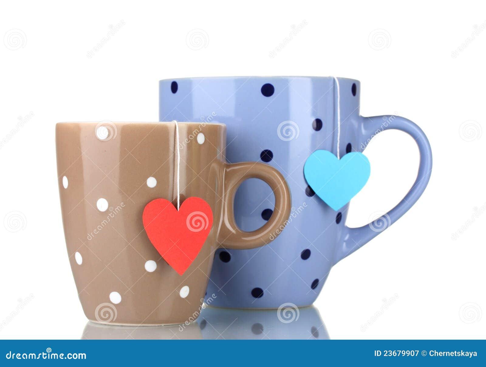 Dos tazas y bolsitas de té