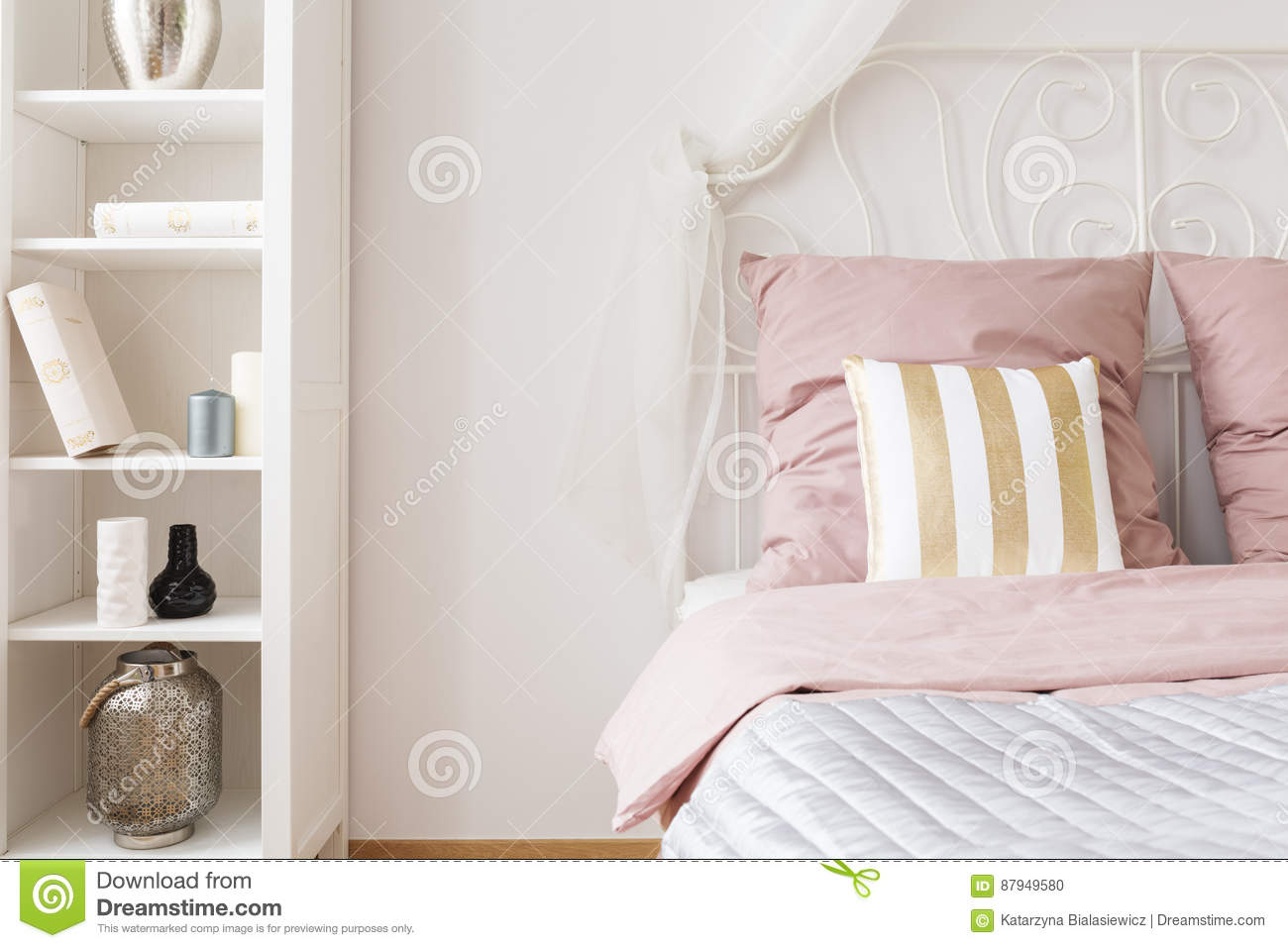 Bedroom With Double Bed Pink Bedding And White Bookshelf