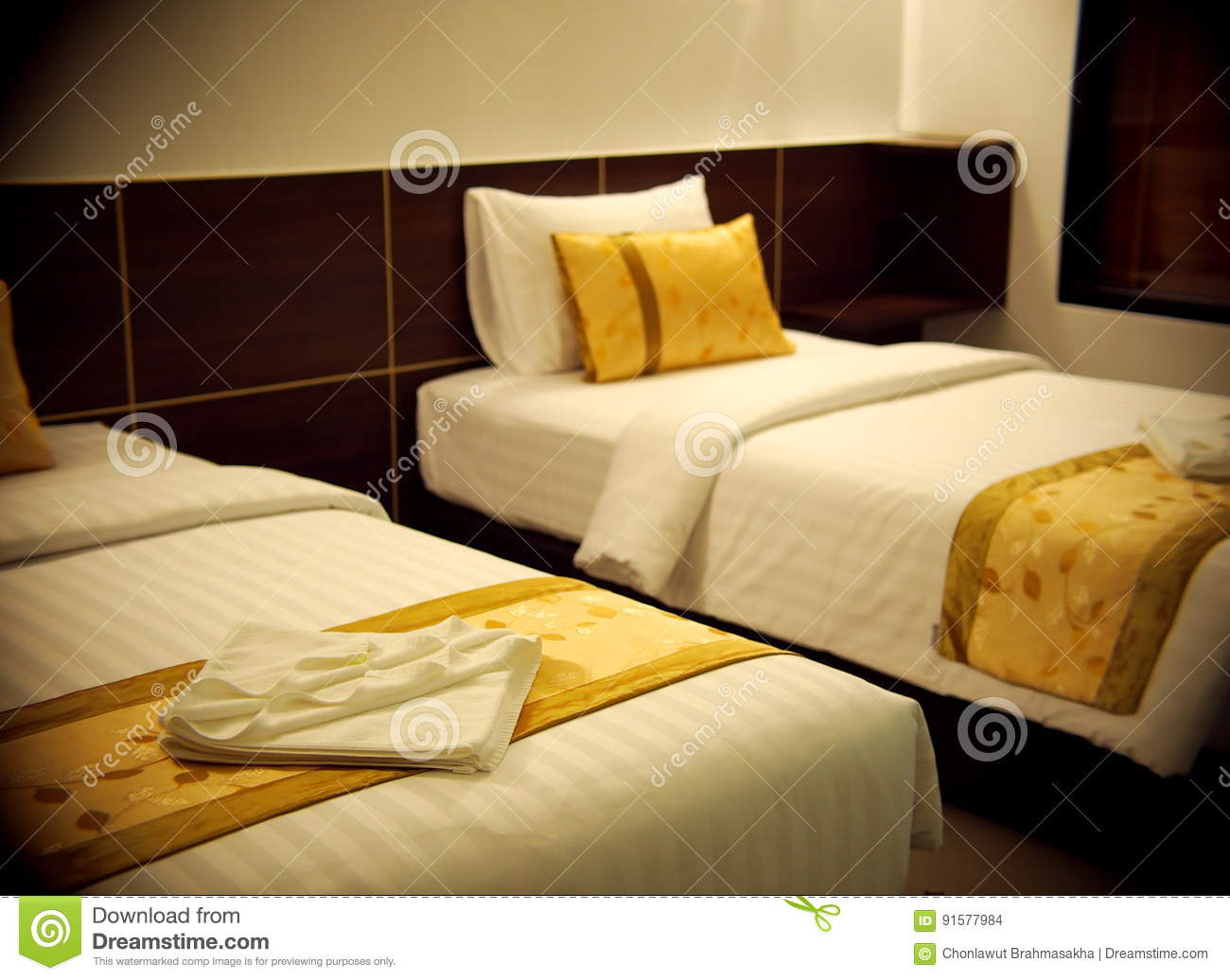 Double Bed Room With Gold Brown Yellow Colour Pillows Stock Photo
