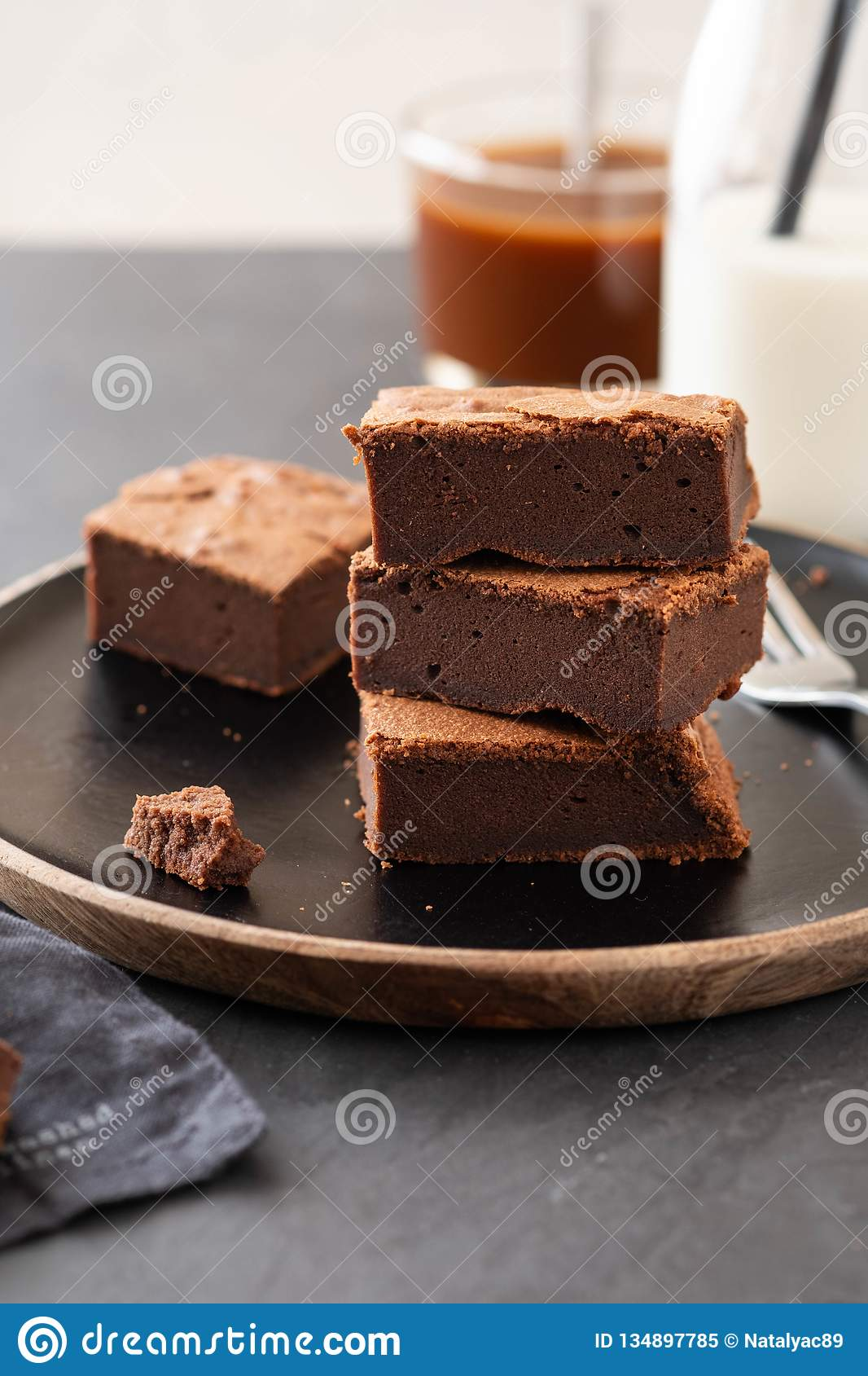 Double Chocolate Brownies. Homemade chocolate fudge brownies with chocolate chips and black background. Copy