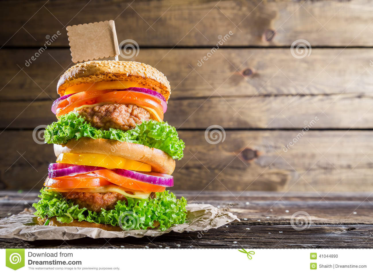 Double decker burger on wooden background with space to for Table burger