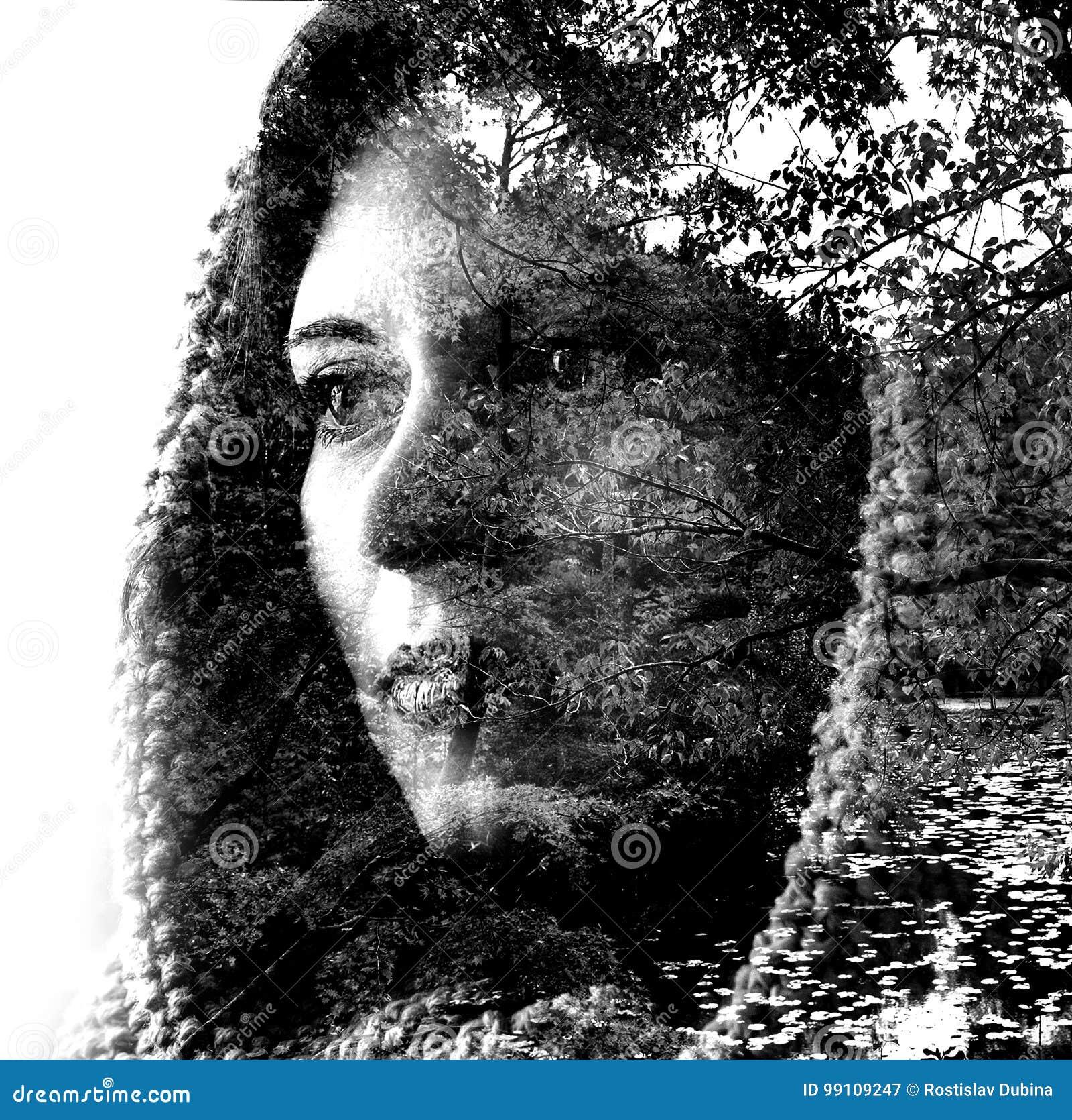 Double exposition d une jeune belle fille par les branches et les feuilles Portrait d une femme, regard mystérieux, yeux tristes,