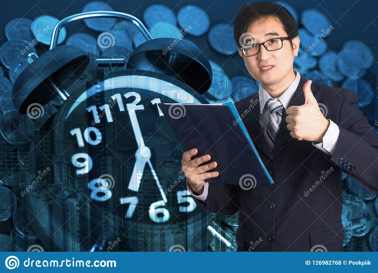 Double exposure of alarm clock and coins stacks with city background businessman and finance graph, time for savings money
