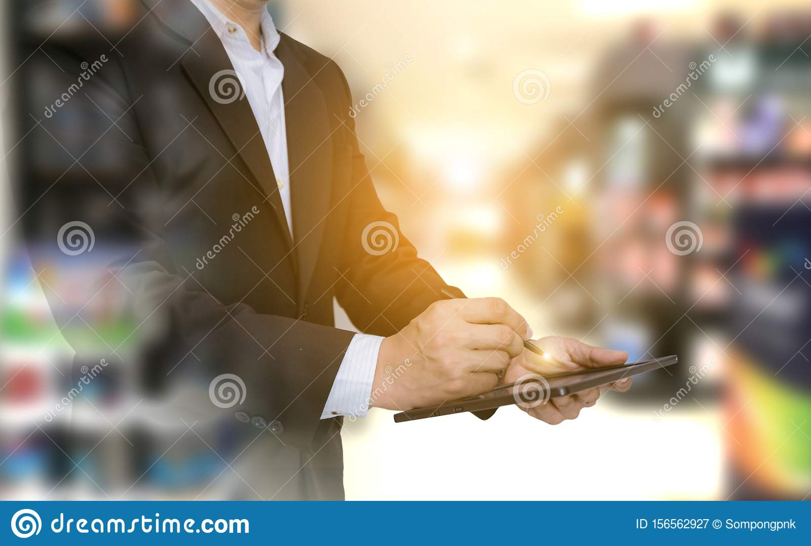 Double exposure business of checking products as hand holding the tablet