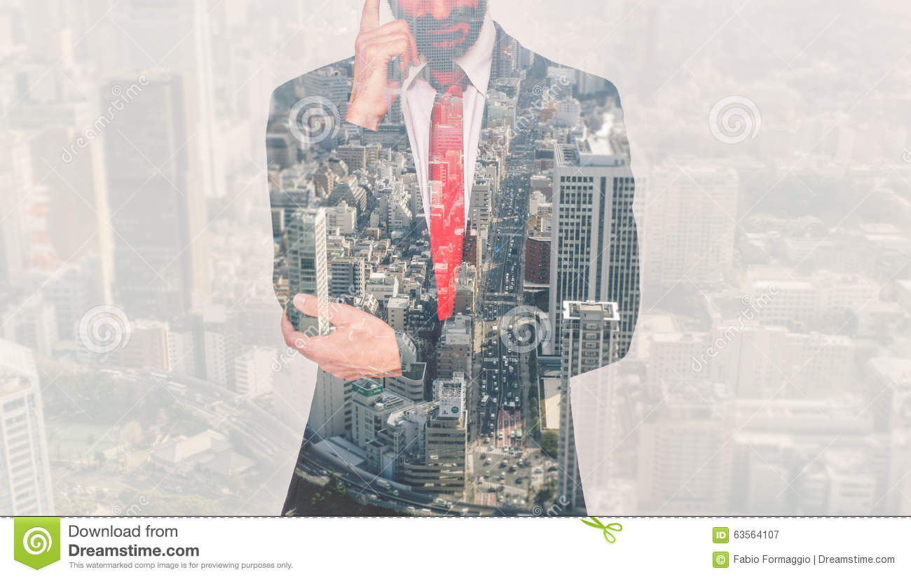 Double exposure with business man and city