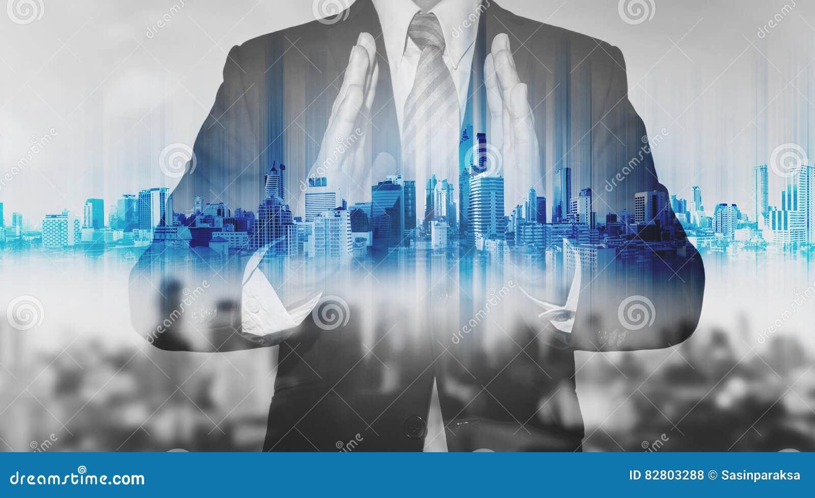 Technology Management Image: Double Exposure Businessman Holding Blue City Hologram