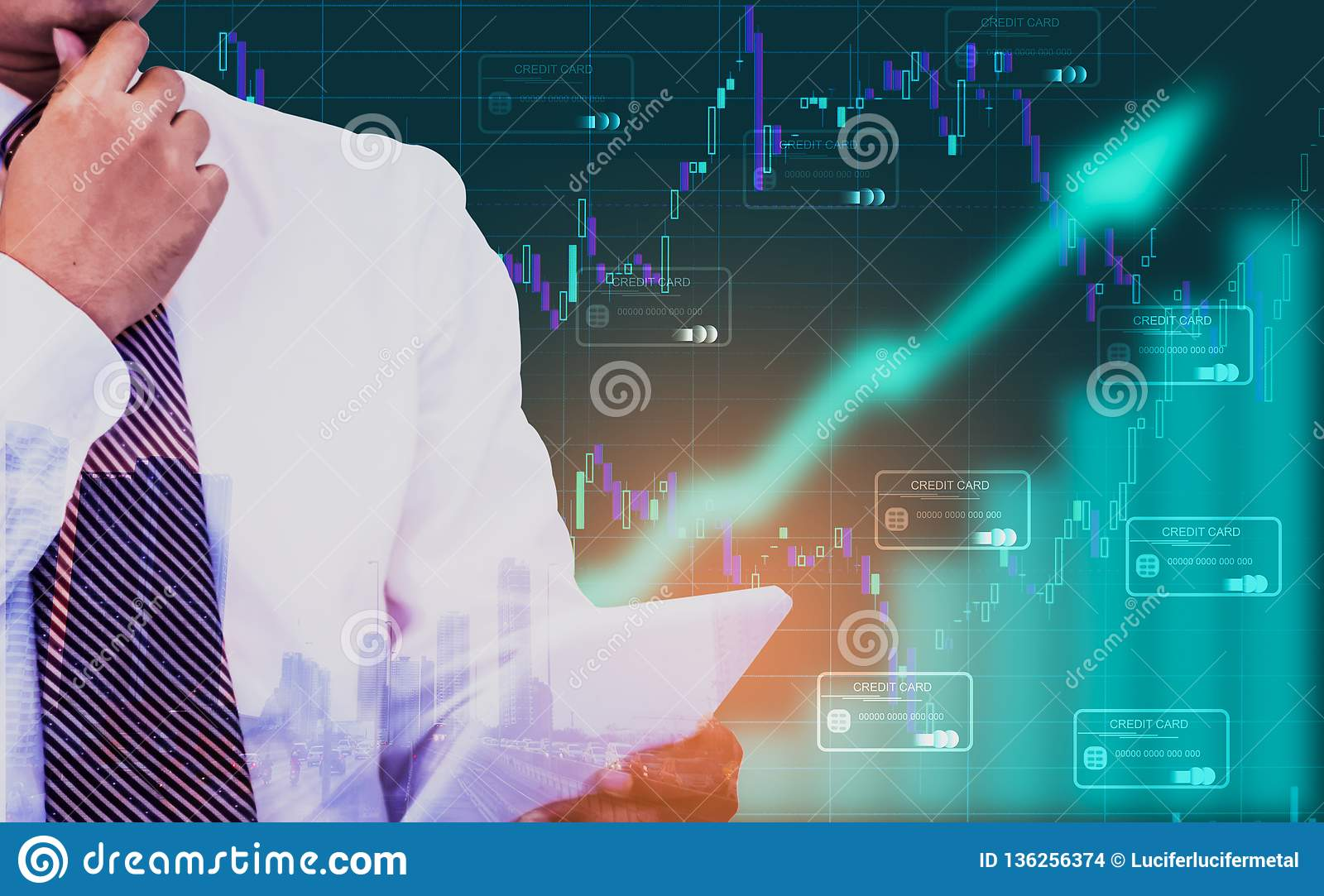 Double exposure - businessman holding a tablet in hand,background an arrow symbol and stock chart,With credit card icon,Concept of