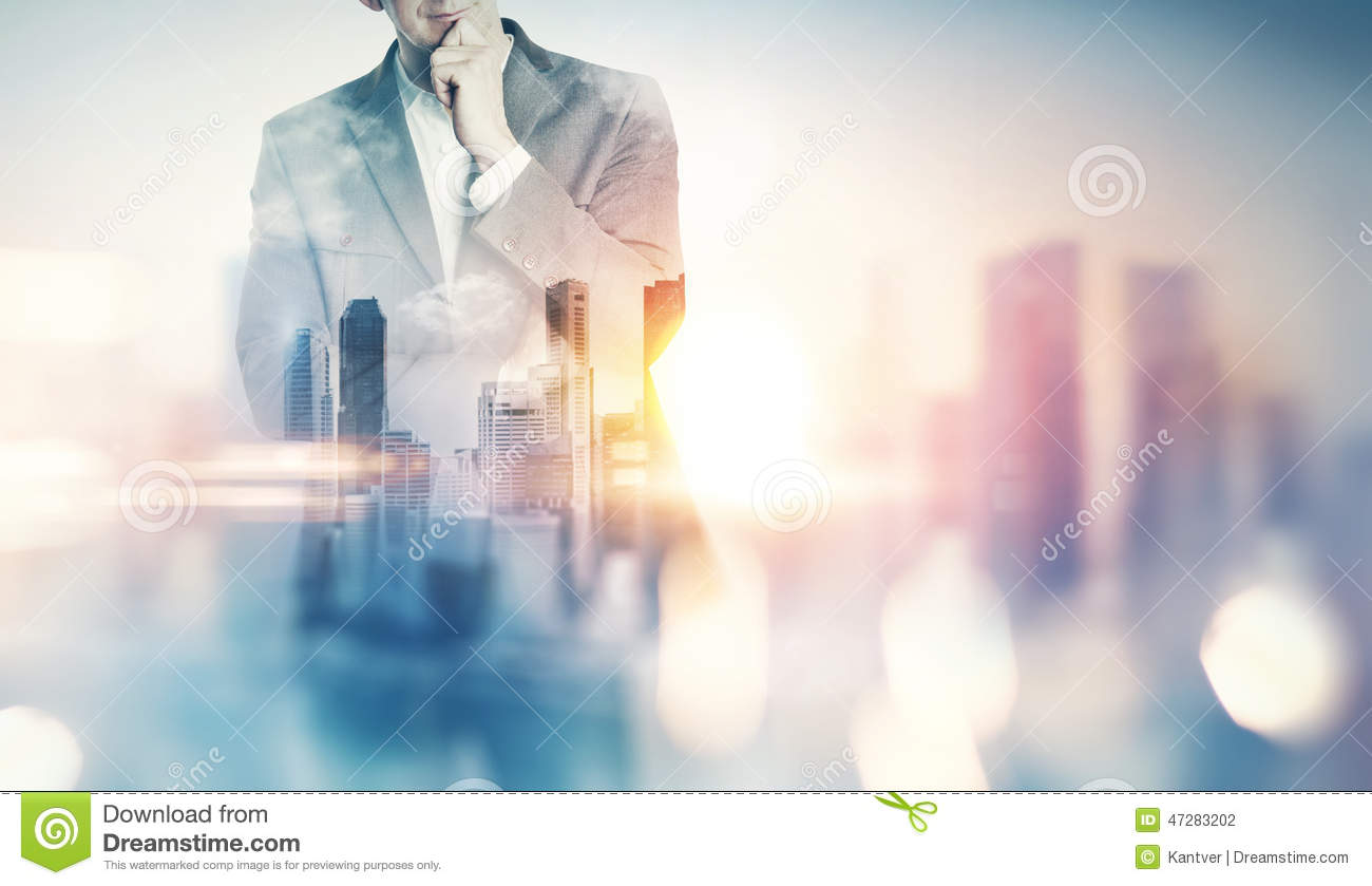 Double exposure of city and business man with light effects