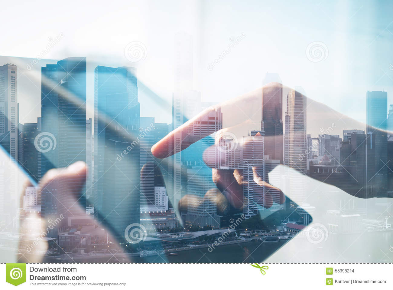Double exposure of city and tablet
