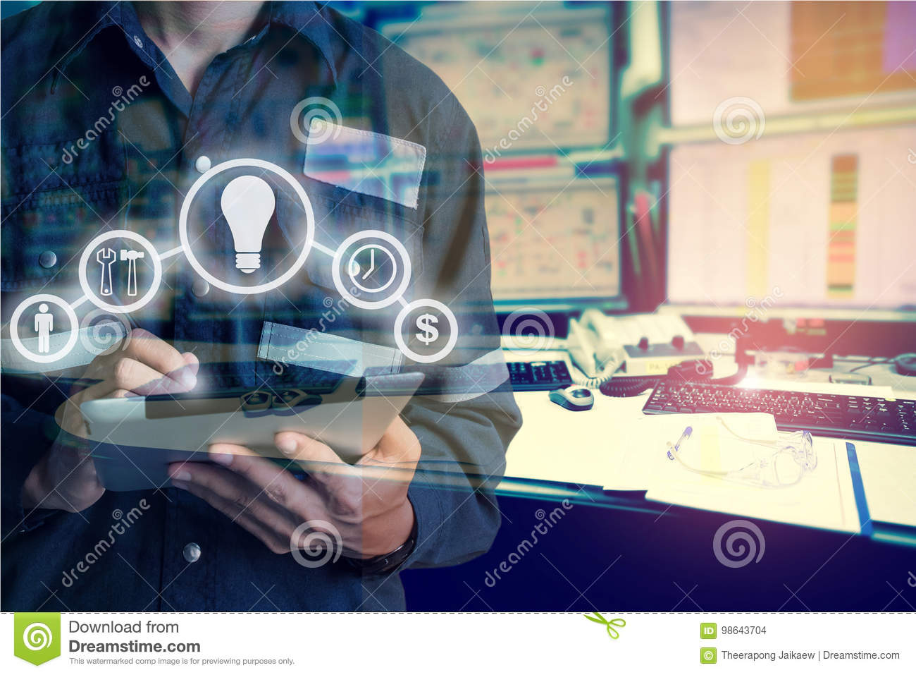 Double exposure of Engineer or Technician man with business industrial tool icons while using tablet with monitor of computers