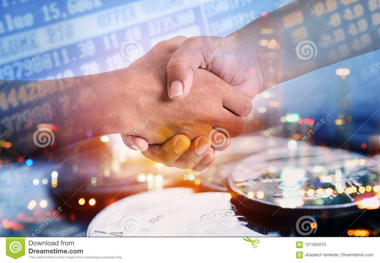 Double exposure of hand shaking with city and coins for finance