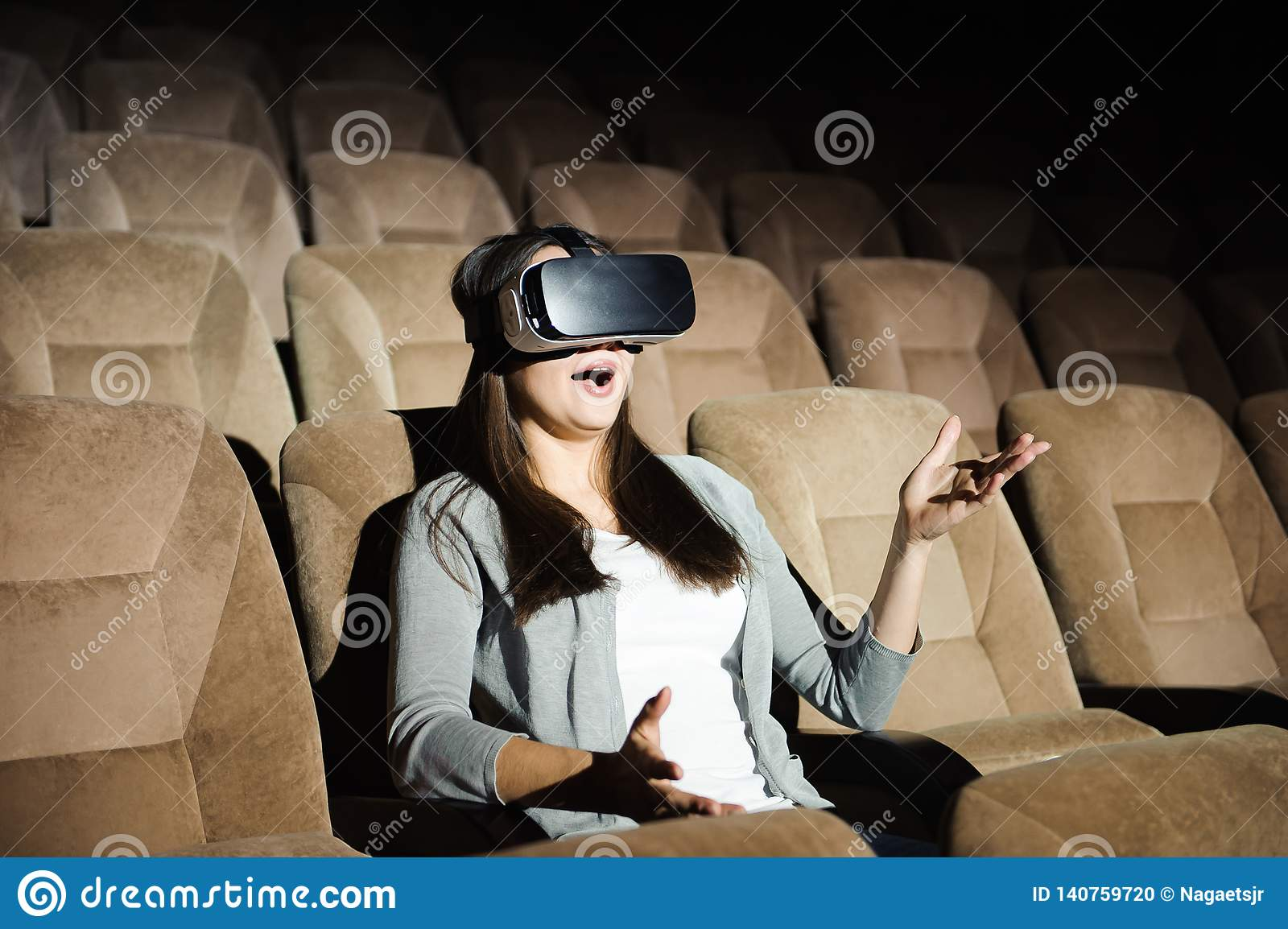 Young Attractive Woman Wearing VR Headset Glasses Of
