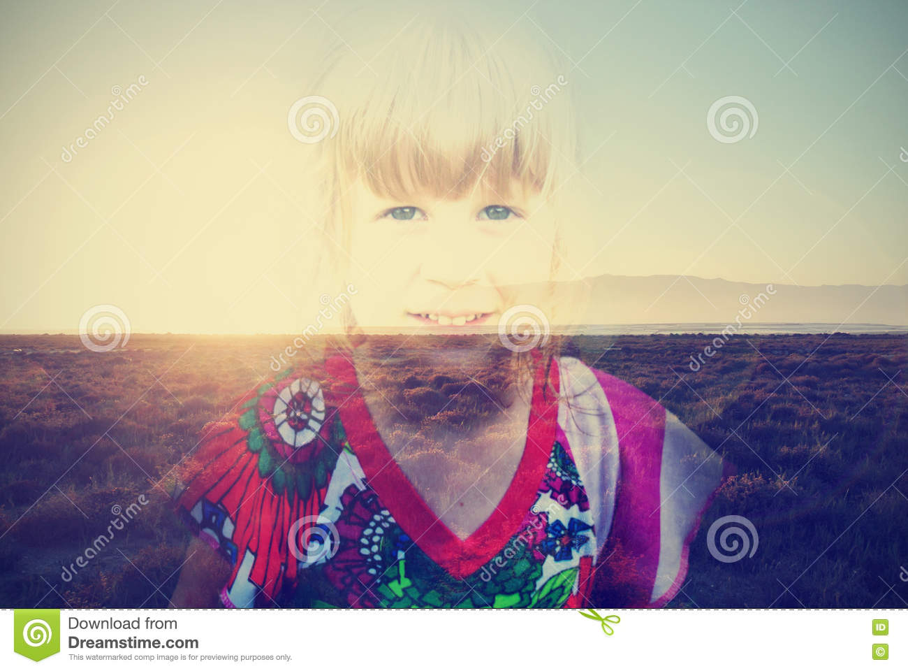 Double exposure image of a little blonde girl and summer sunset; retro styele