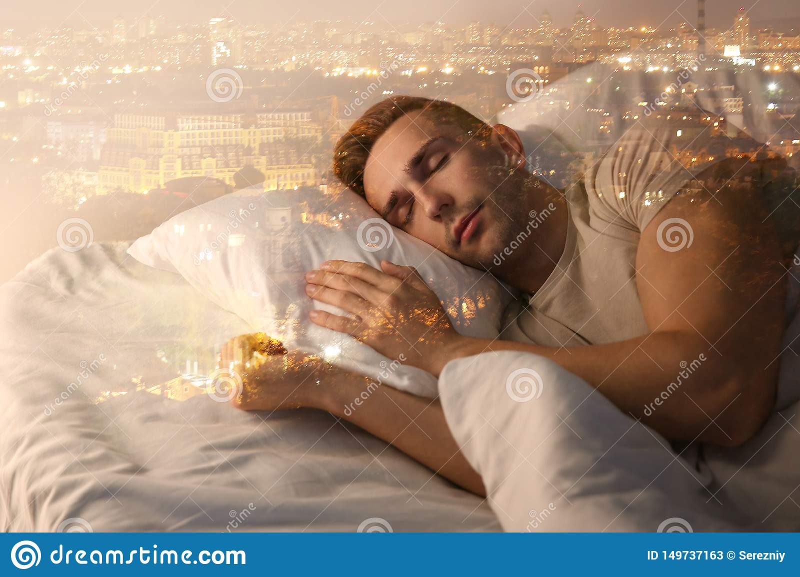 Young Man Sleeping On Side In Bed At Night Stock Photo ...   Man Sleeping In Bed At Night
