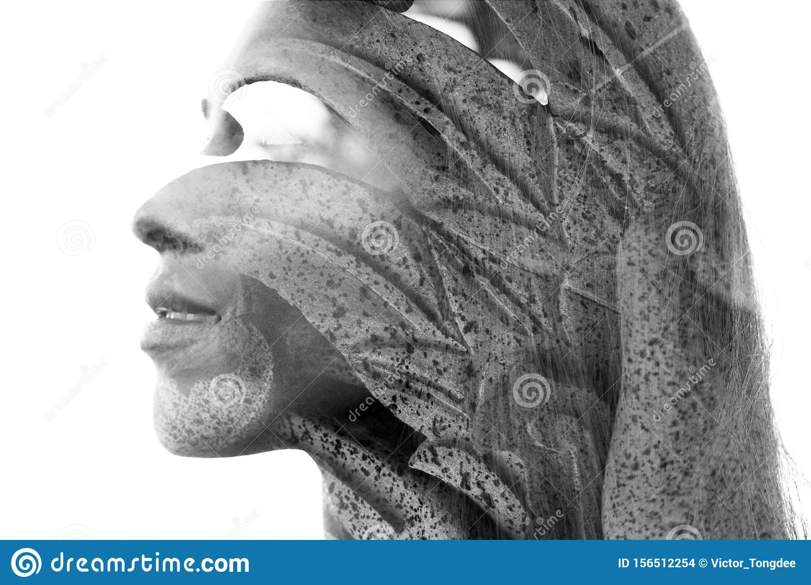 Double exposure close up portrait of an attractive young woman combined with a Balinese rock statue with leaf texture, black and
