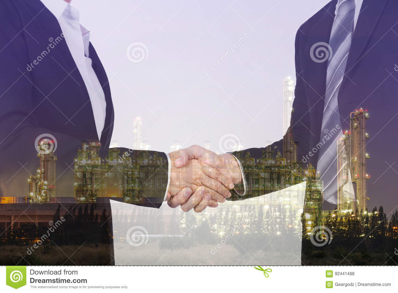 Double exposure of shaking hand between businessman and business