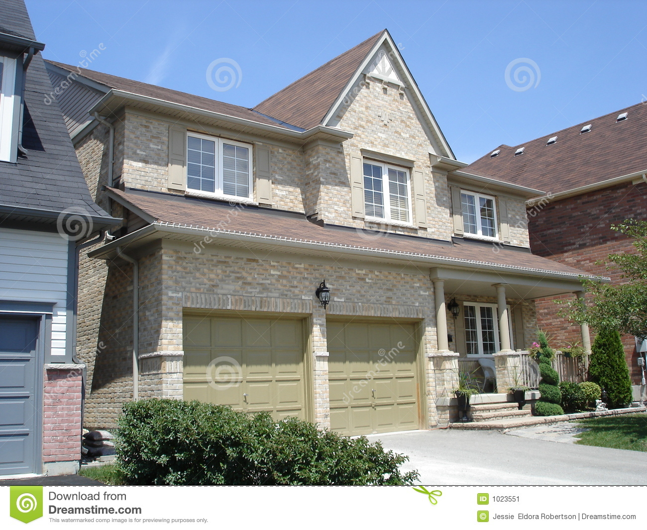 Double Garage On Stylish Brick House Stock Image