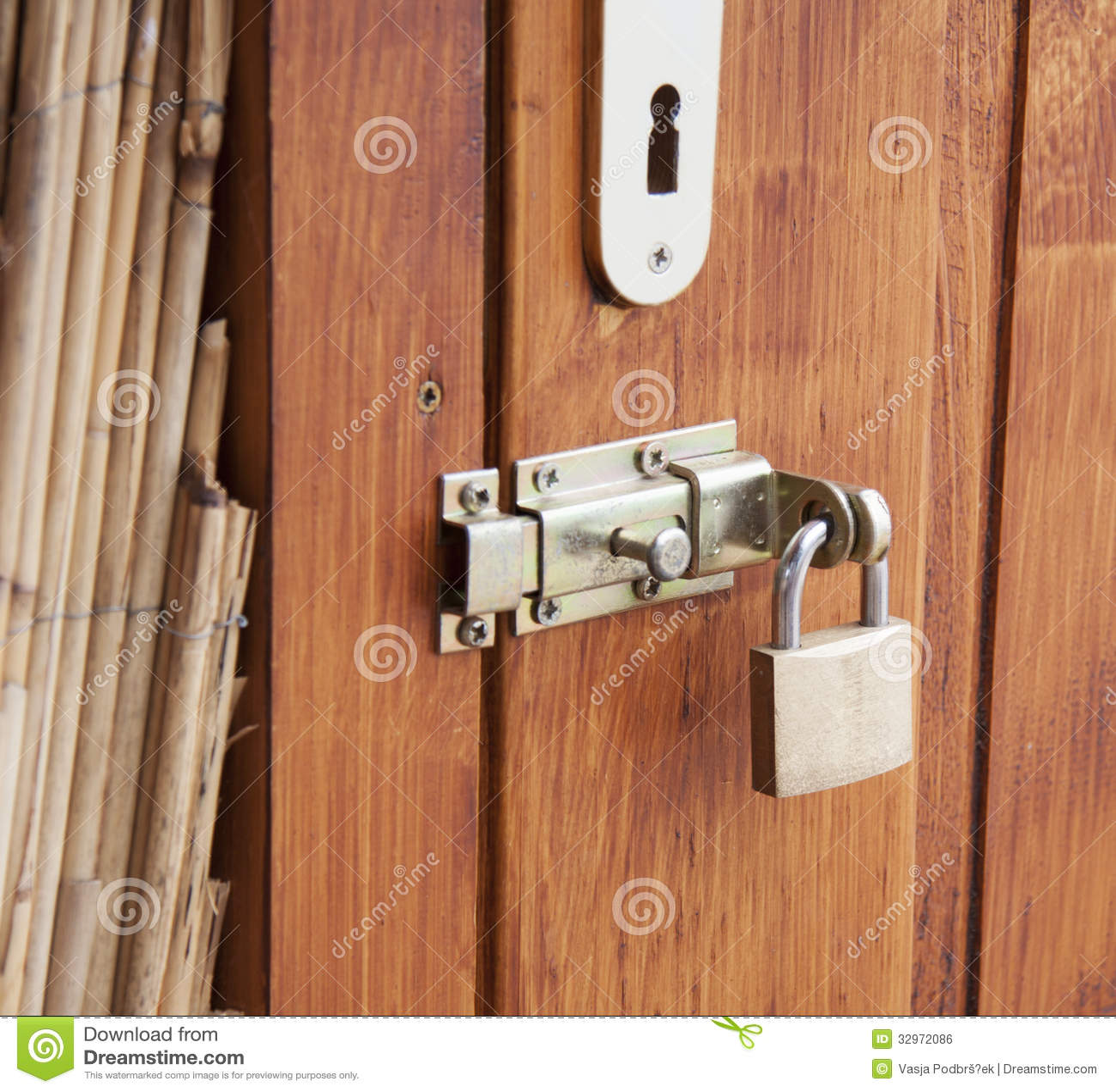 Double security stock photo image of locking lock door