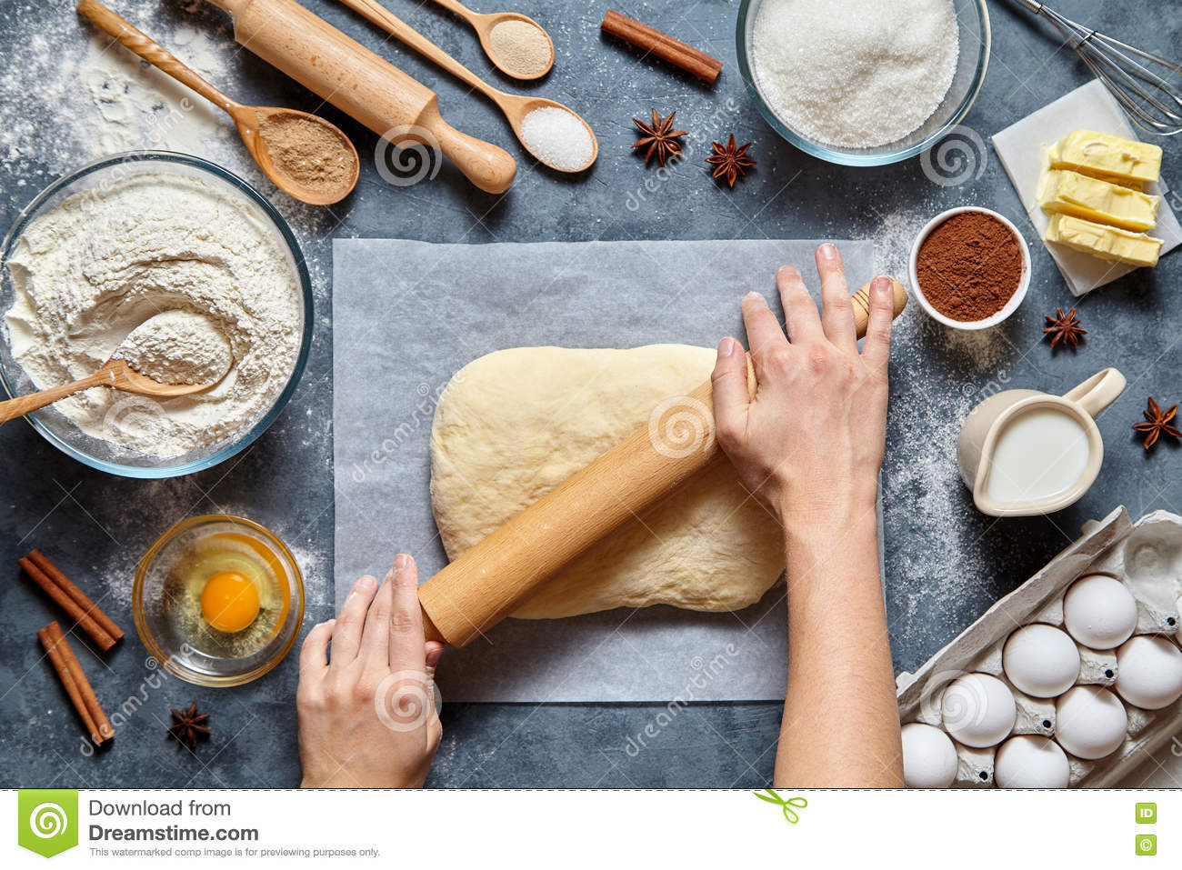 Dough bread, pizza or pie recipe preparation. Female baker hands rolling with pin.
