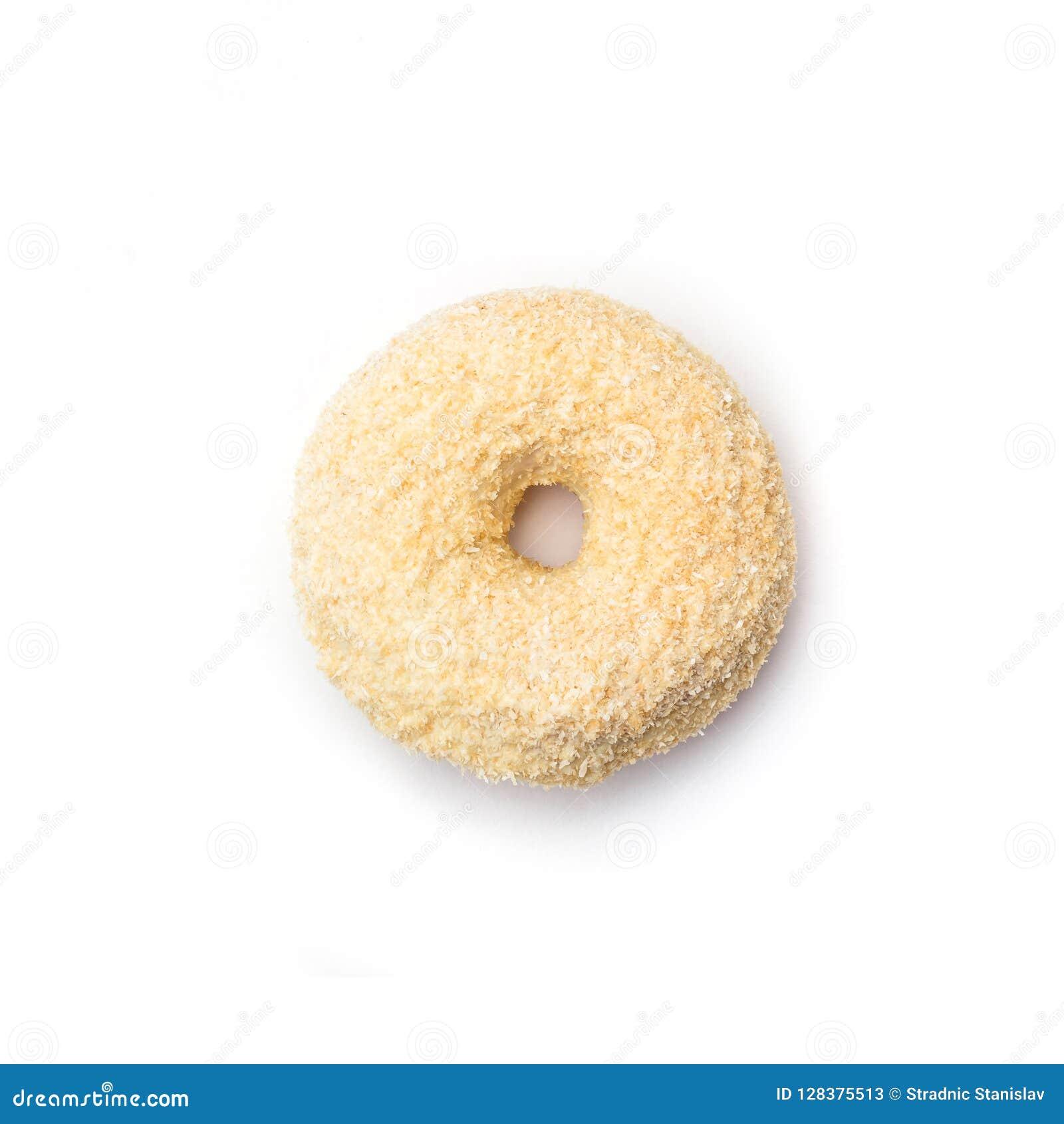 Doughnut met room en kokosnoot, op witte achtergrond wordt geïsoleerd die Hoogste mening
