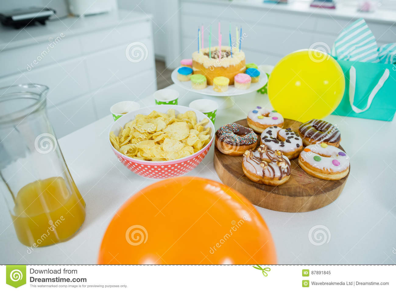 Super Doughnuts Potato Chip Birthday Cake And Balloons On Table Stock Personalised Birthday Cards Paralily Jamesorg