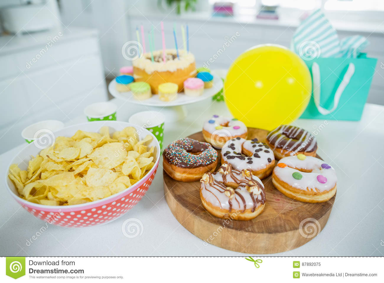 Stupendous Doughnuts Potato Chip Birthday Cake And Balloons On Table Stock Personalised Birthday Cards Paralily Jamesorg