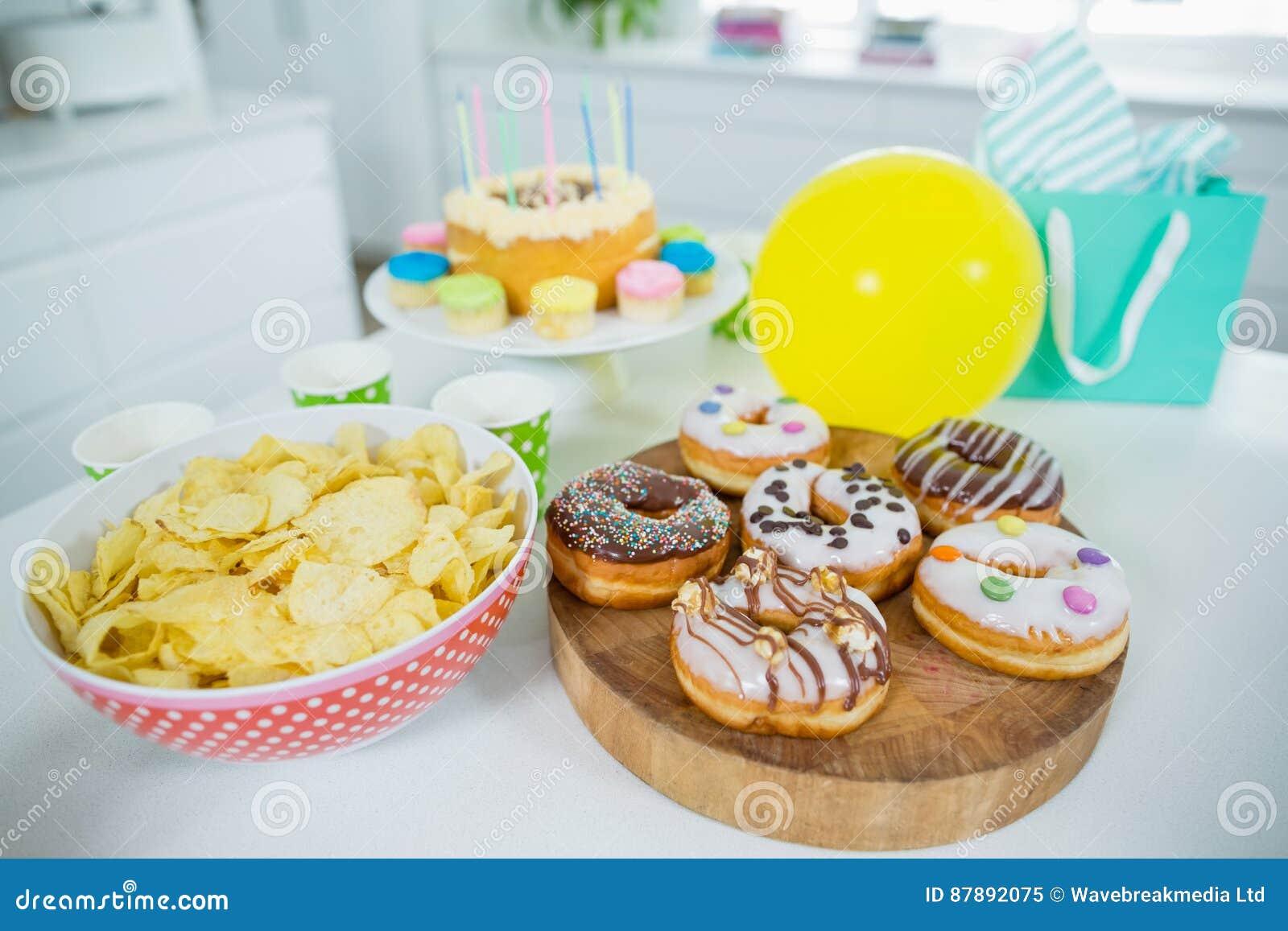 Cool Doughnuts Potato Chip Birthday Cake And Balloons On Table Stock Personalised Birthday Cards Veneteletsinfo