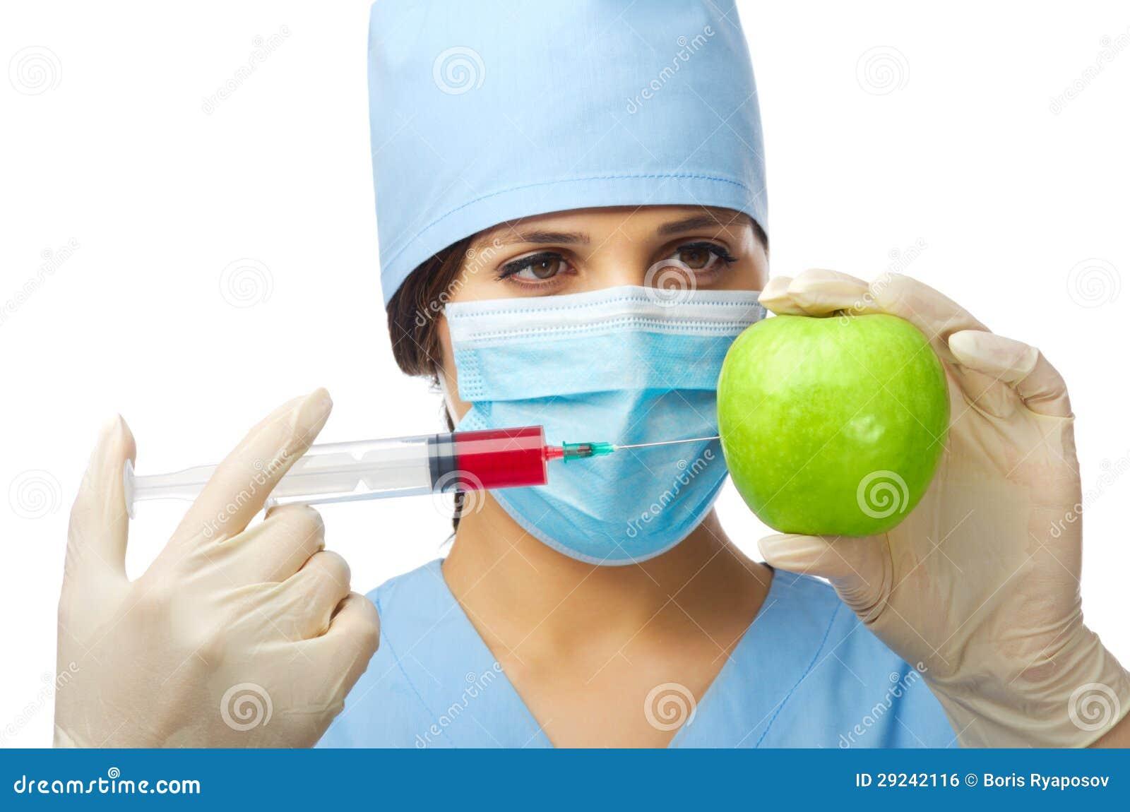 Download Doutor Novo Com Maçã E Seringa Foto de Stock - Imagem de botânico, chemical: 29242116
