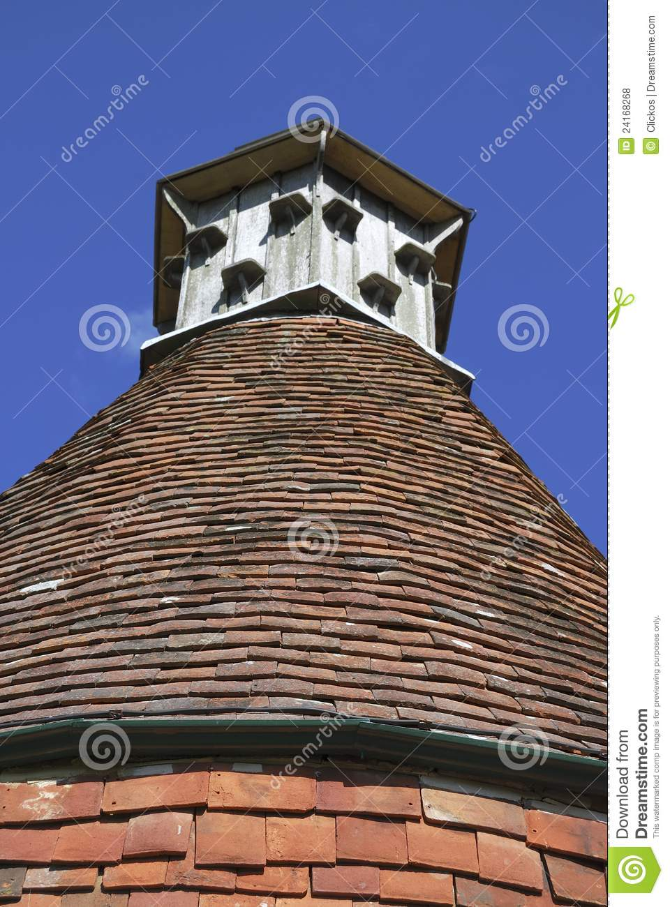 Dovecote On Tiled Roof Of English House Stock Photo