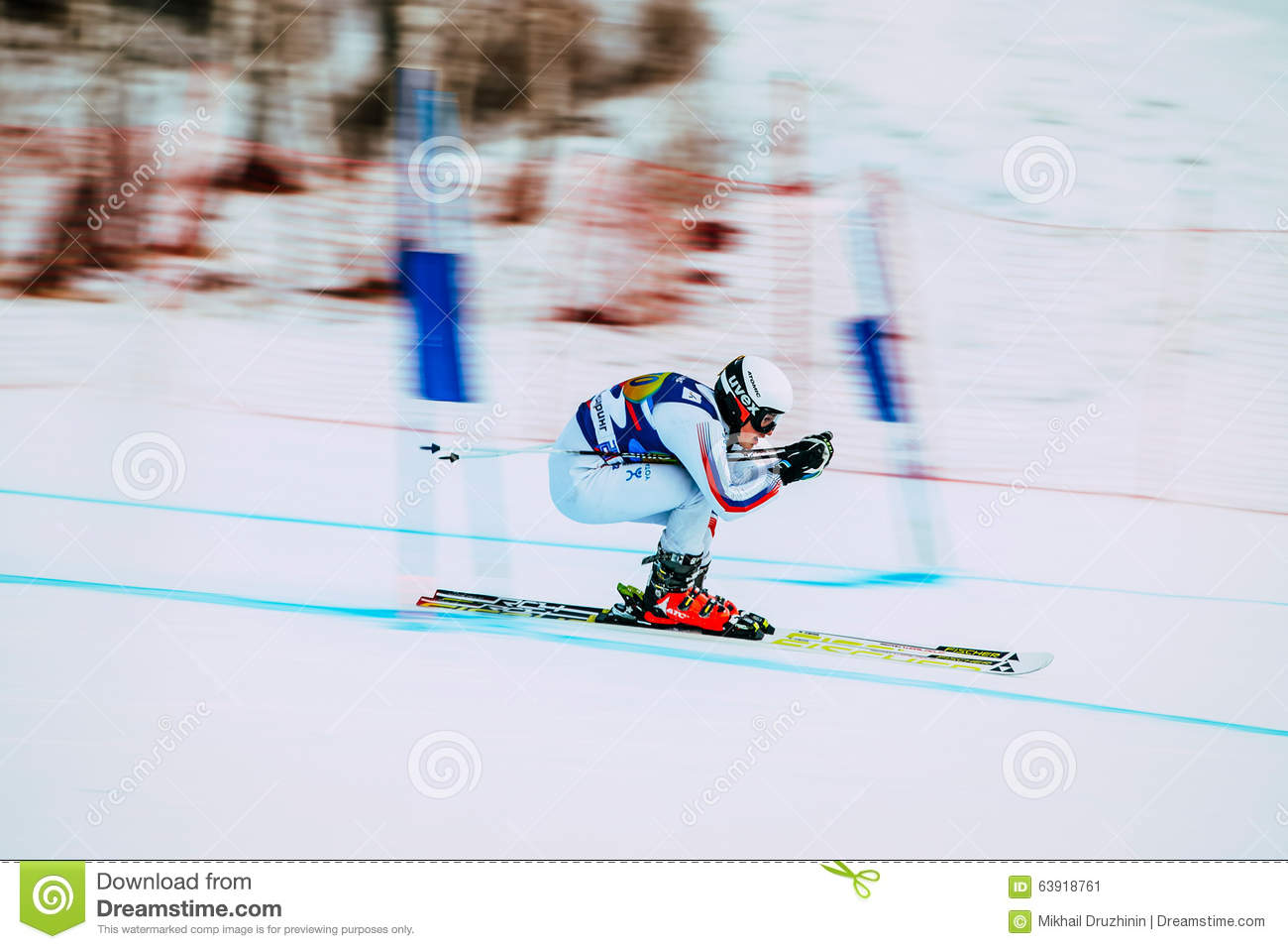 Downhill young girl athlete skiing to competition Russian Cup in alpine skiing. background blur effect