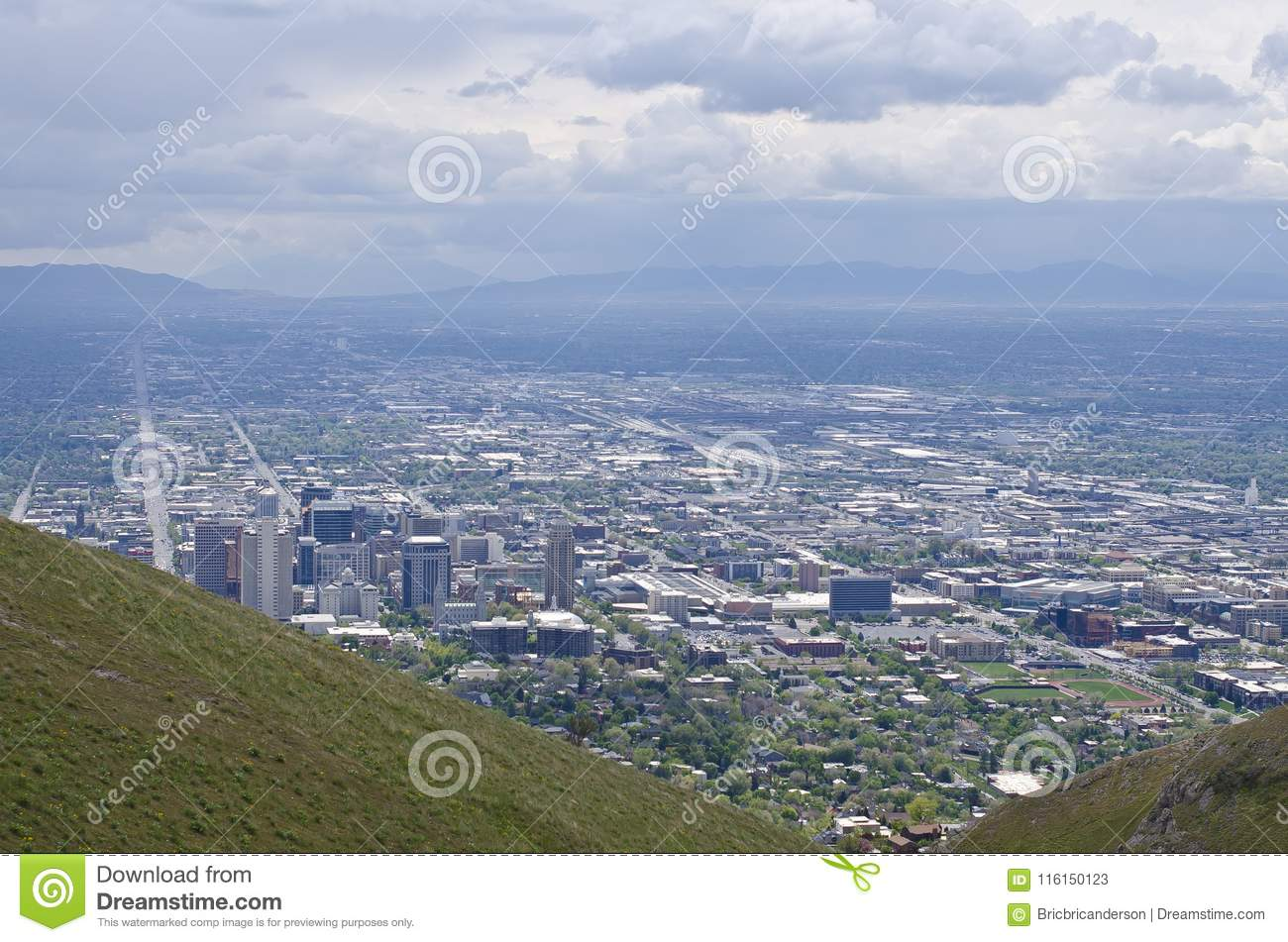 A view of the roads and buildings far above the salt lake city valley from  the mountain side on a nice summer day. - Downtown Salt Lake City Hillside Landscape Stock Image - Image Of