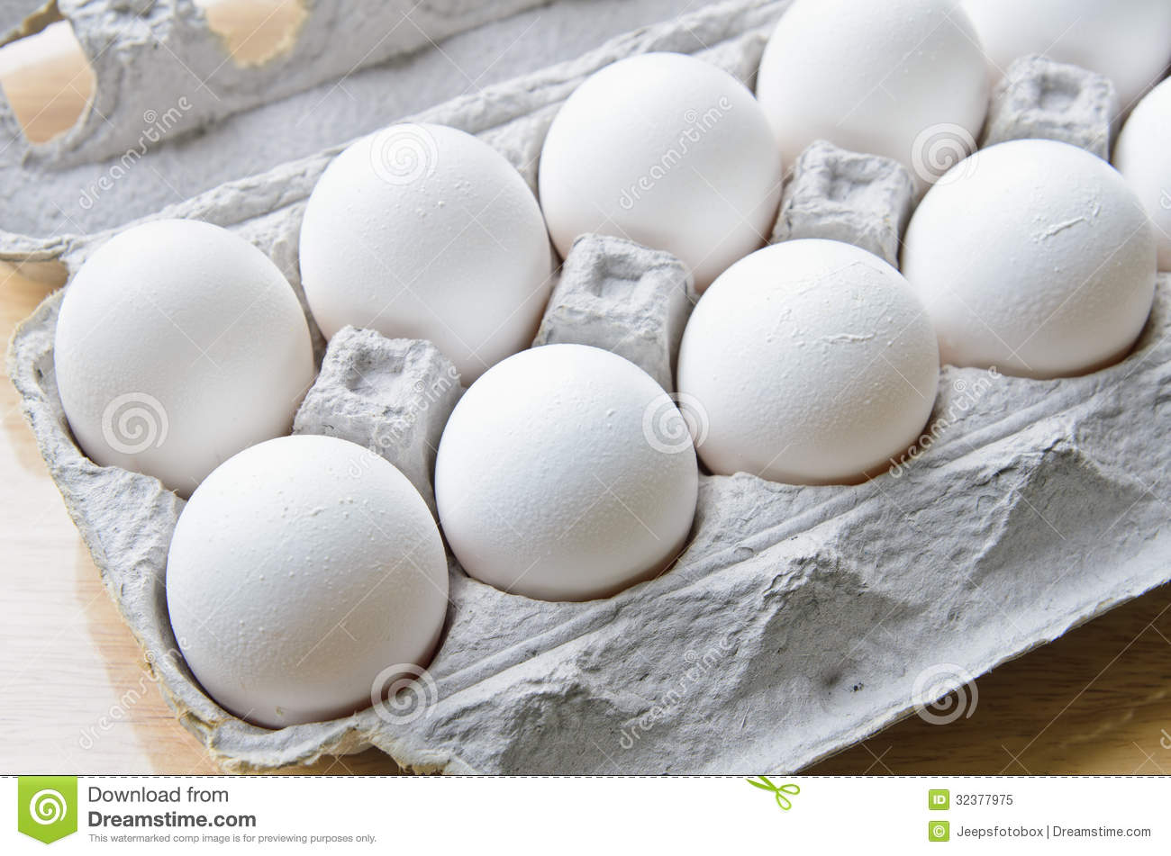 A Dozen Of Eggs In A Box Royalty Free Stock Photo - Image ...